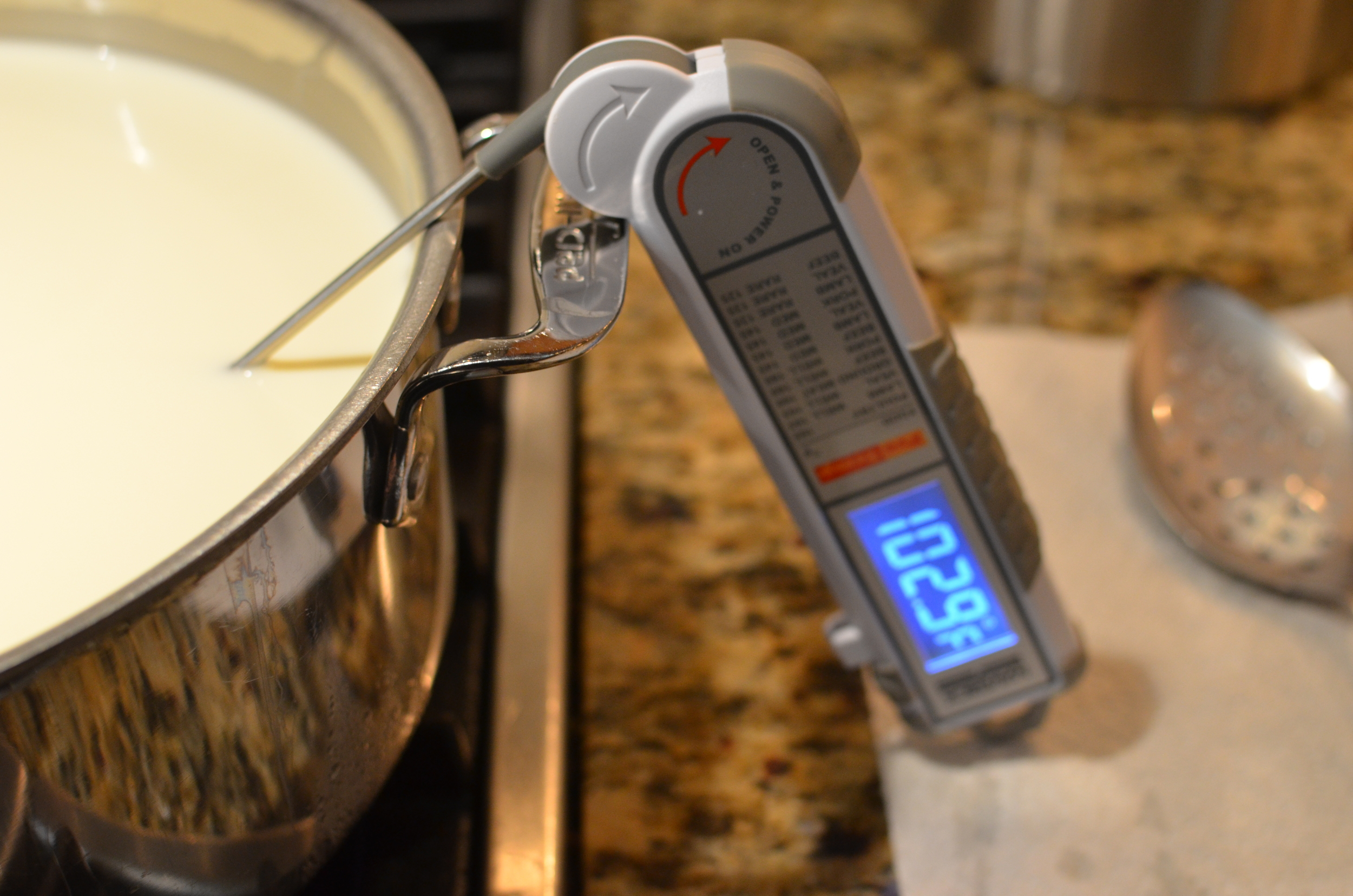 Use a digital thermometer to monitor the temperature of the milk and cream. Make sure the probe doesn't rest against the bottom or sides of the pan.