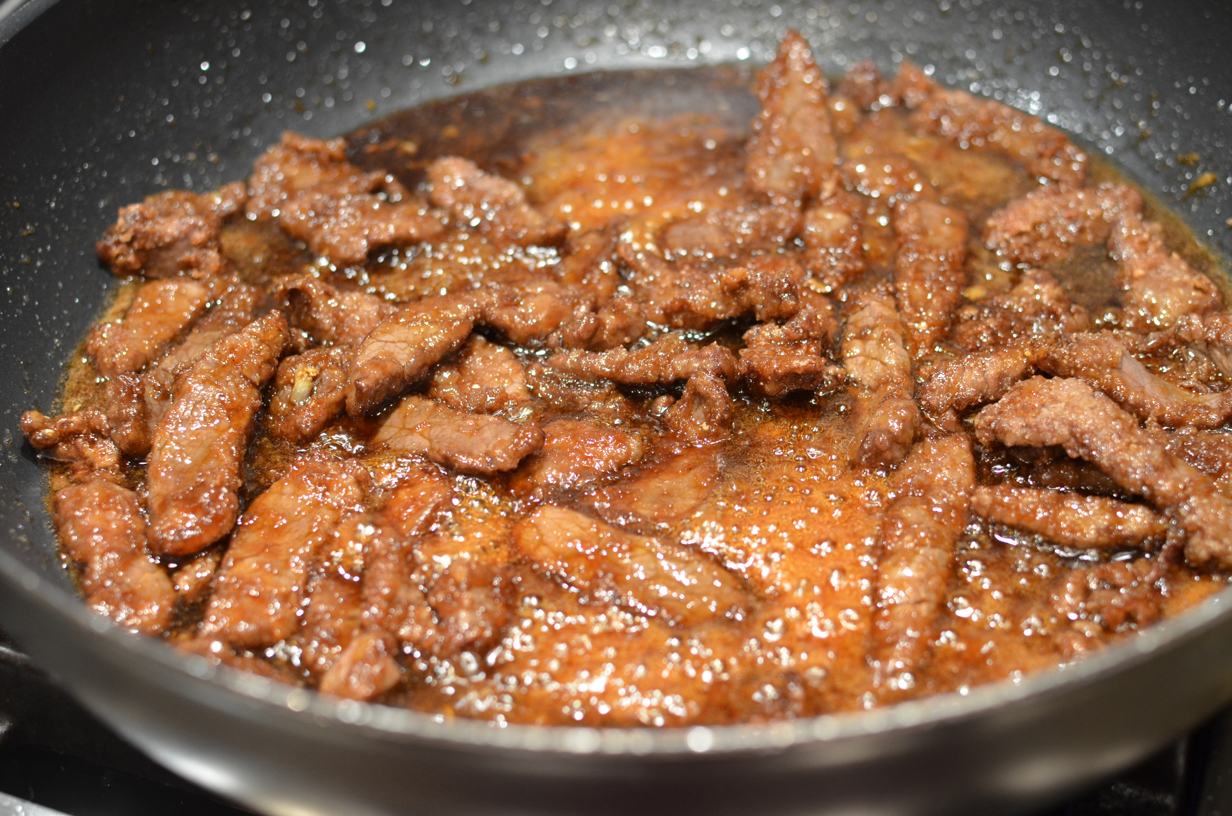 Return sauce to heat; add steak strips and stir for several minutes until cooked through.