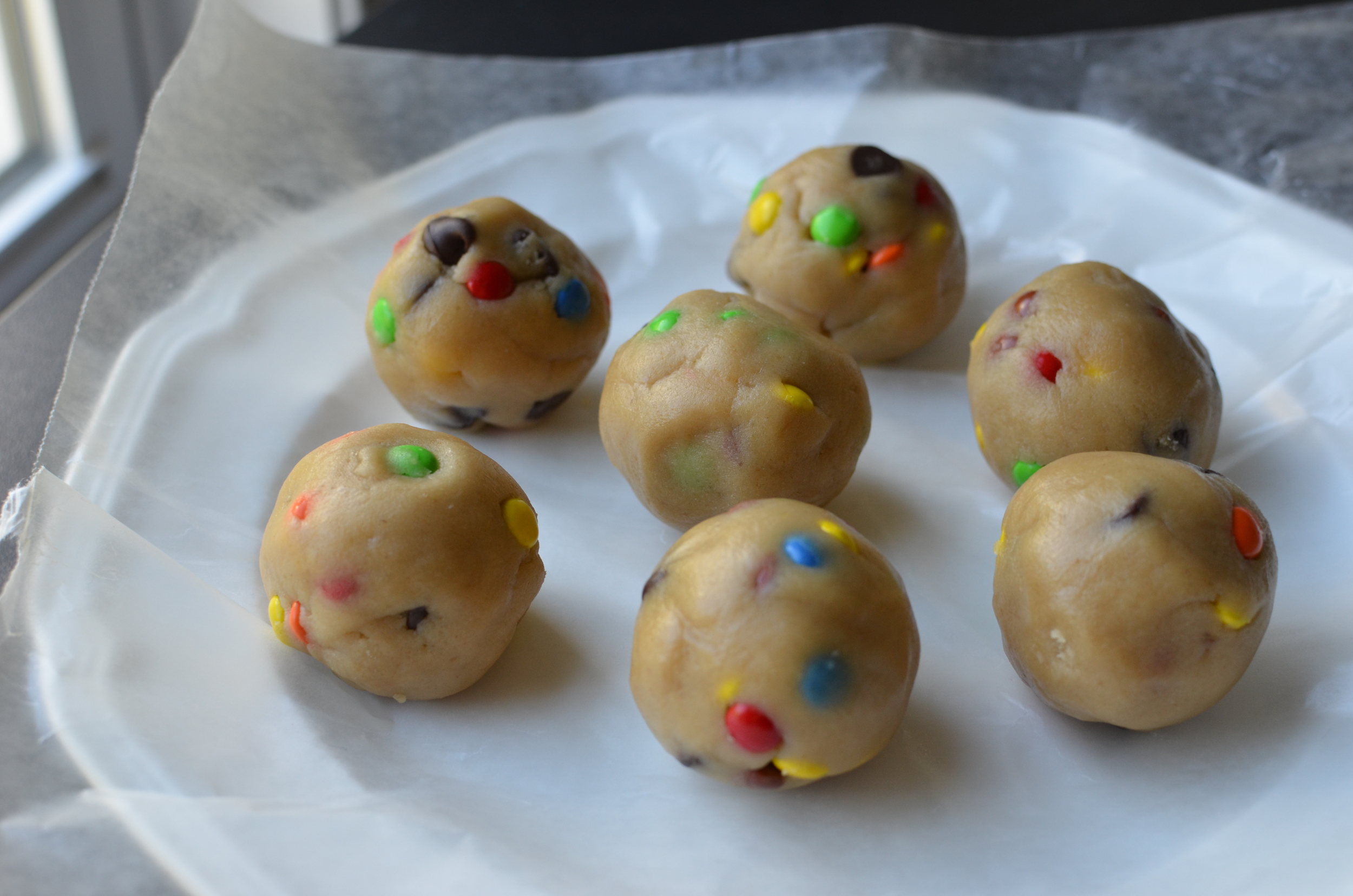 When it's time to bake the cookies, use the heat of your hands to roll the cookie dough into smooth balls.