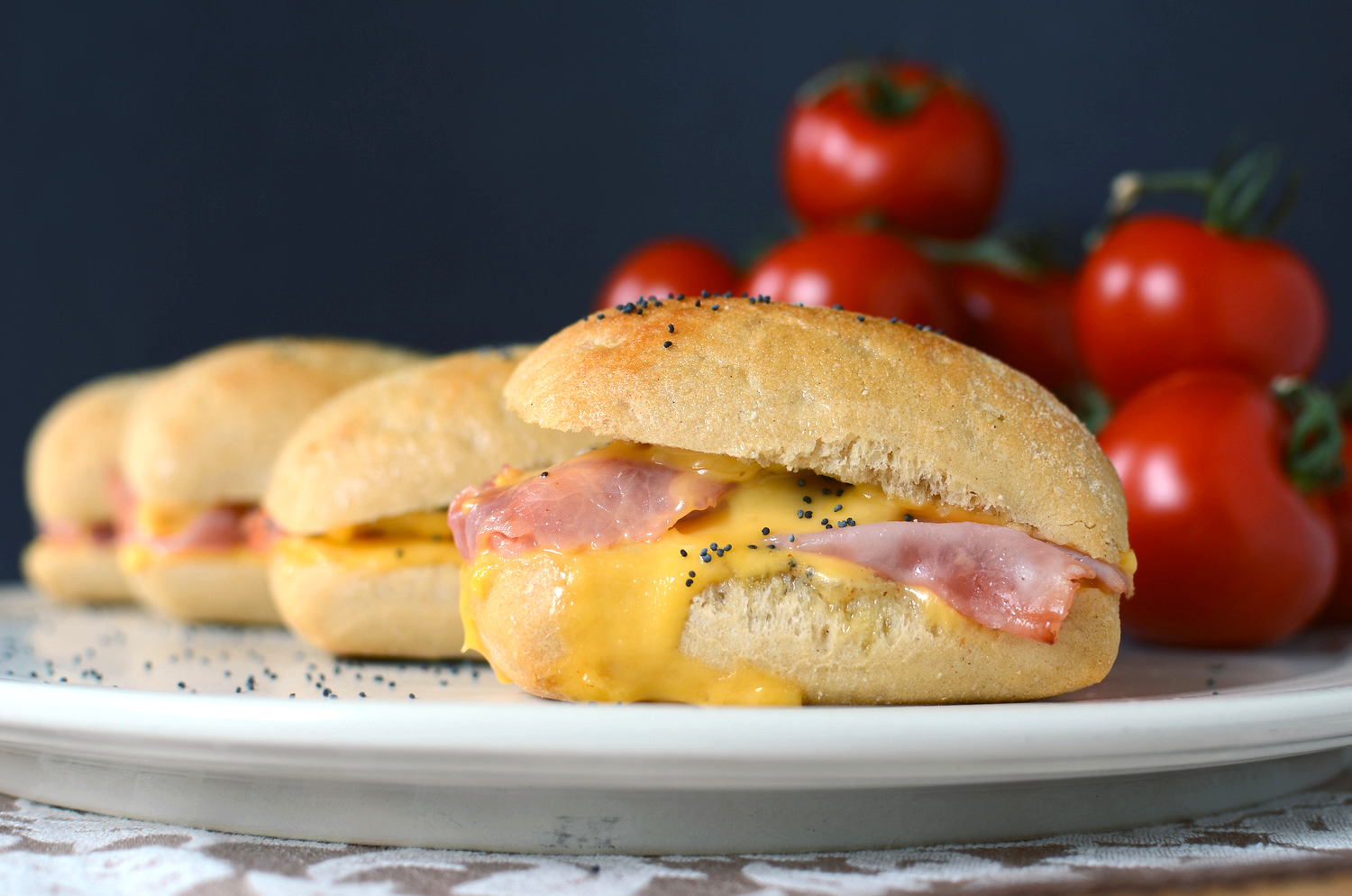 Hot Ham and Cheese Sandwiches with Onion Butter - ButterYum. oven baked sandwiches. football food recipes. foods for the big game. game day recipes. tailgate recipes. big game finger good. game appetizers. game sandwiches. hot sandwich recipe.