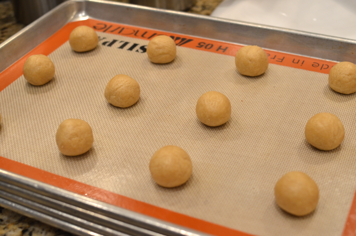 Roll the dough into round balls. Bake in a preheated oven for 10-12 minutes, turning the pan halfway if your oven has hot spots.