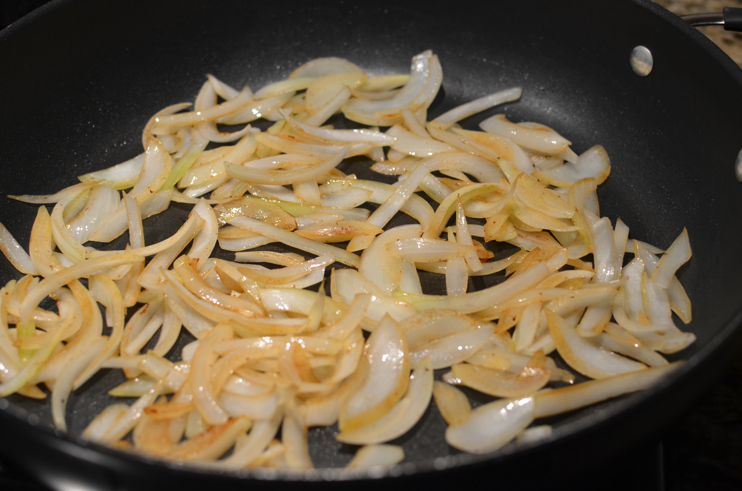 Stir the onions occasionally until they turn translucent and begin to caramelize.
