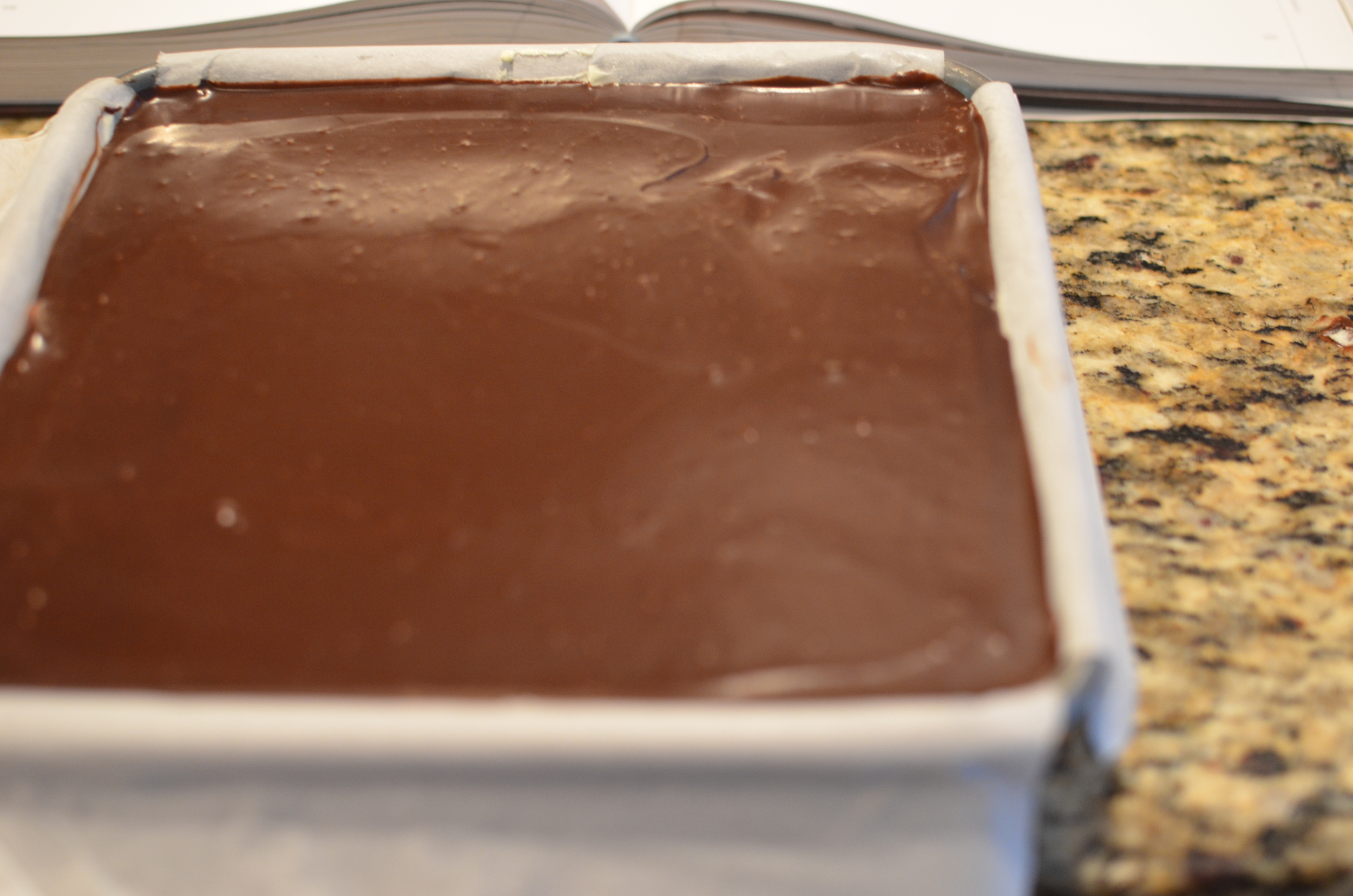 Spread the ganache layer on top of the white chocolate buttercream layer and chill well before unmolding.