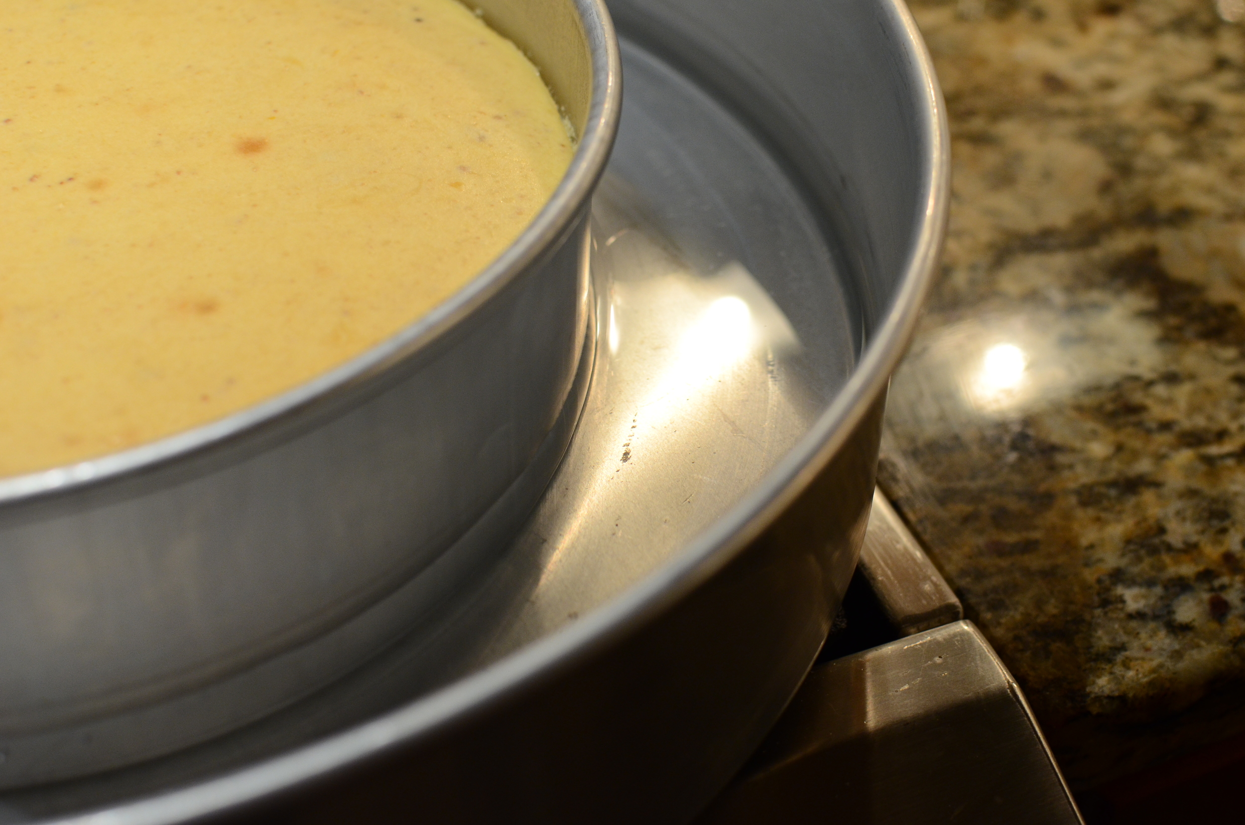 Bake as directed, the turn off the oven and cool for an hour without opening the oven door.  Then remove from the oven and cool on the counter for 1-2 hours =.  This will cool the cheesecake slowly, preventing it from cracking.  Chill the cheesecake for at least 4 hours, but overnight is even better.  Cheesecakes will pick up off flavors from the fridge, so I place mine in an airtight container to chill.    I unmolded the cheesecake and place it on a cardboard cake round.  If I were to do it again, I'd use a coated cardboard because the one I used was uncoated and it quickly became saturated with moisture from the cheesecake.