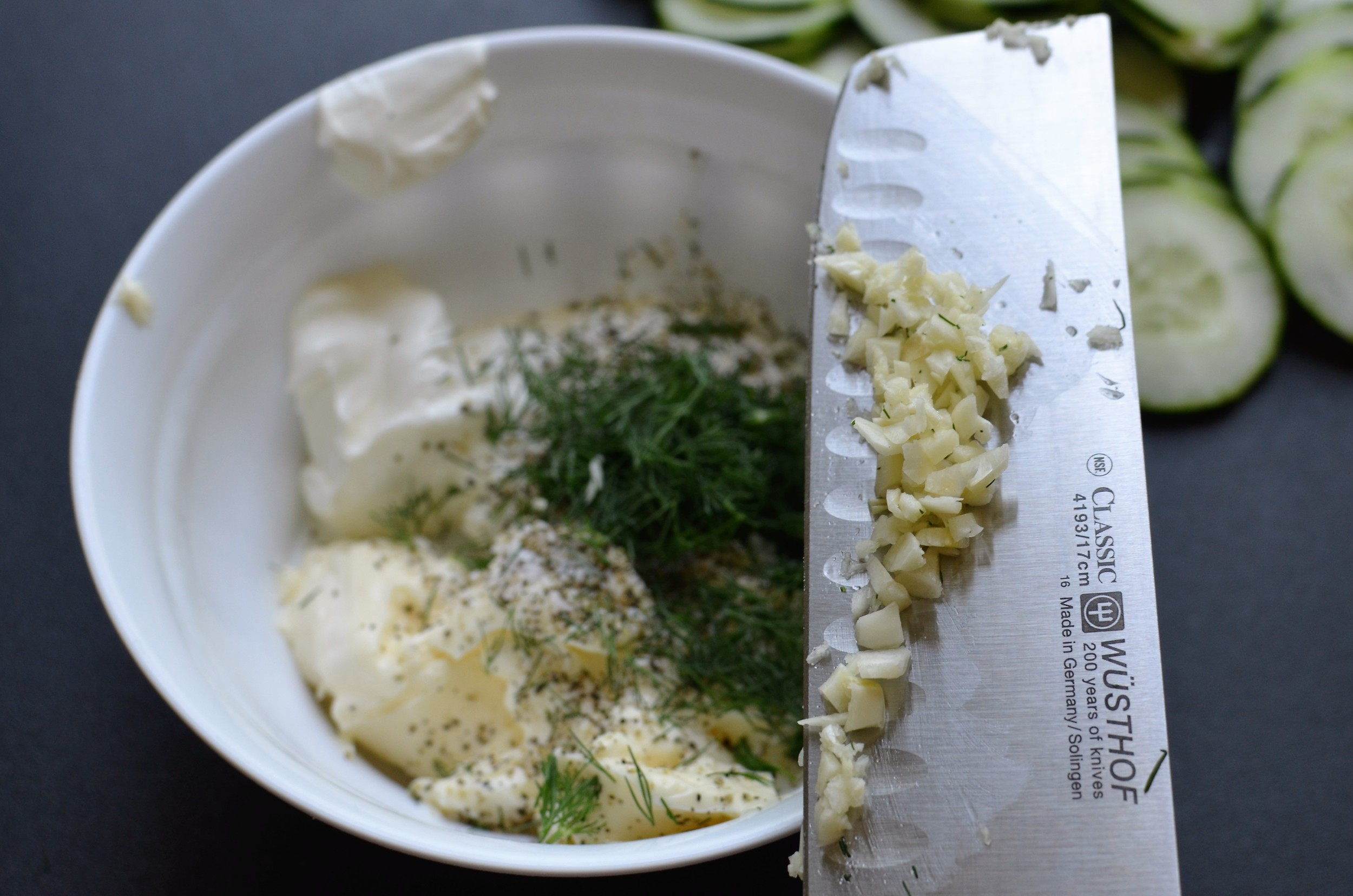 how to make the dressing for cucumber salad usuing plain greek yogurt or sour cream, mayo, fresh dill, minced fresh garlic, salt and pepper.