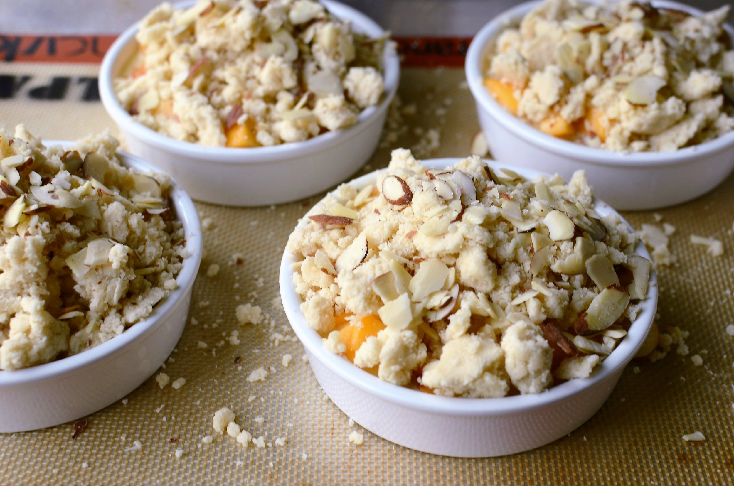 Peaches and Cream Custard Crumble - ButterYum — peaches and cream dessert.  baking with peaches.  peach recipes.  peach dessert recipes.  baking fresh peaches.  baked peaches.