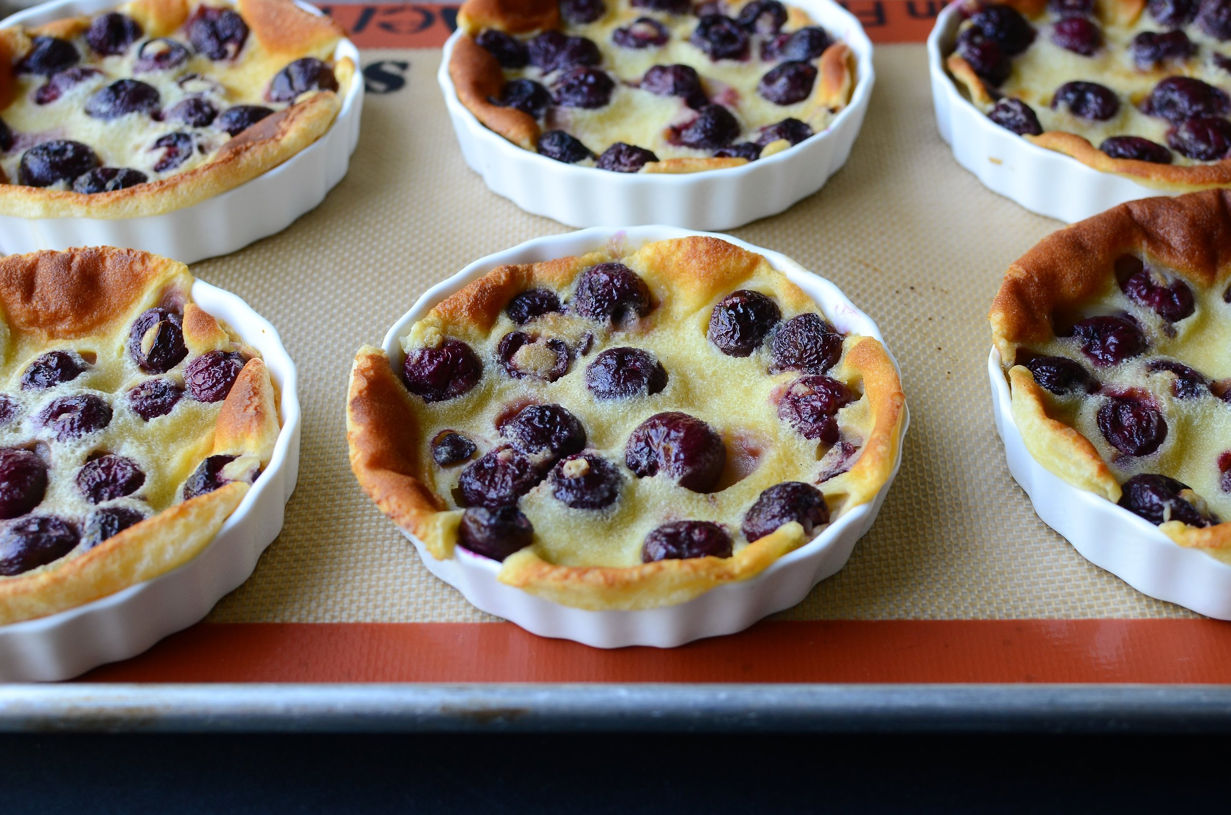 Cherry Clafoutis - ButterYum. French clafoutis recipe. how to make individual clafoutis. recipe for cherry clafoutis. dessert recipe for sweet cherries. cherry dessert recipe. easy French dessert recipe.