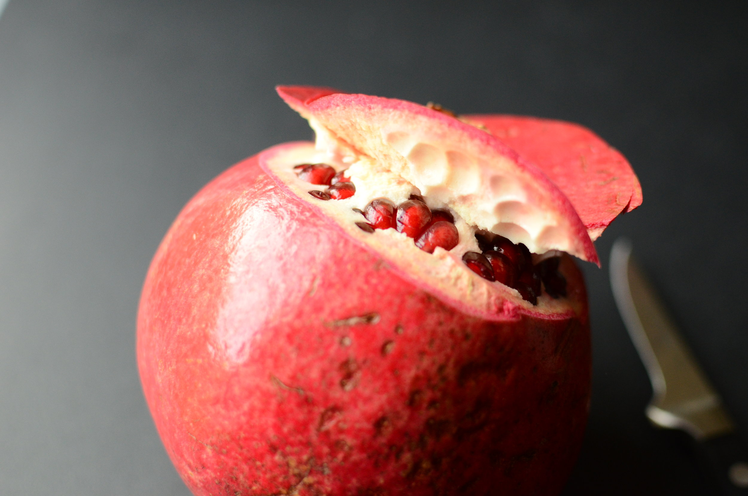 official way to open a pomegranate. opening a pomegranate.