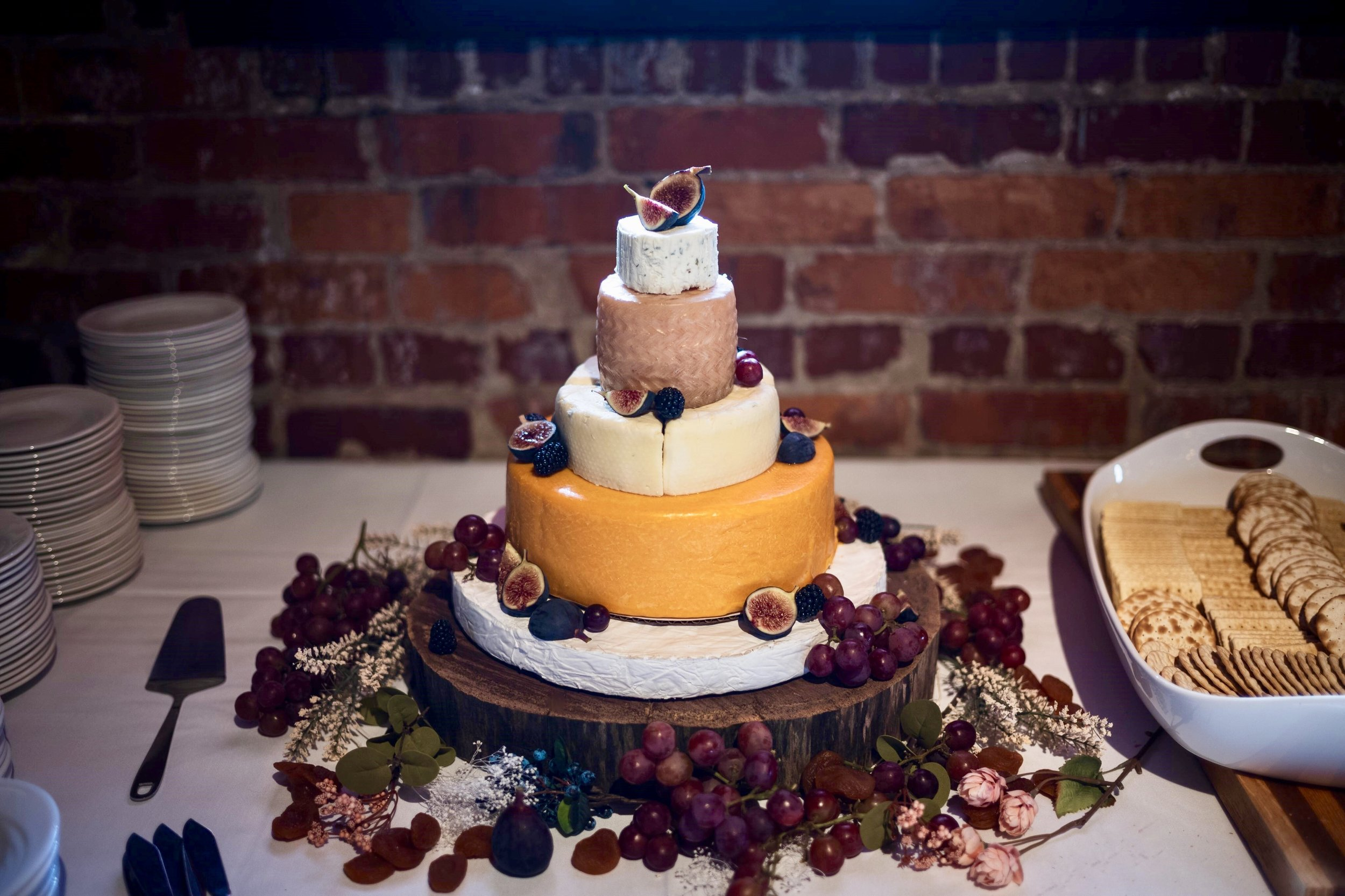 How to Make a Cheese Wheel Wedding Cake - ButterYum. how to make a non traditional wedding cake. how to make your own wedding cake. how to make a wedding cake out of cheese. how to make a wedding cake from wheels of cheese. wedding wheel cheese cake. Stacked cheese wedding cake. How many pounds of cheese do I need? Alternative wedding cake ideas. wedding cake alternatives. how to make your own wedding cake. DIY wedding cake. tower of cheese wedding cake. how to make a tower of cheese wedding cake. how to make a non cake wedding cake. how to make a wedding stack of cheese cake. how to decorate a cake made of cheese.