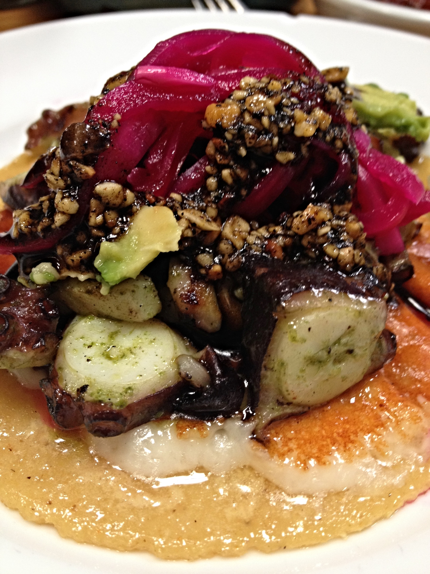 Charcoal Grilled Octopus with chile de arbol, peanuts, jack cheese, and avocado