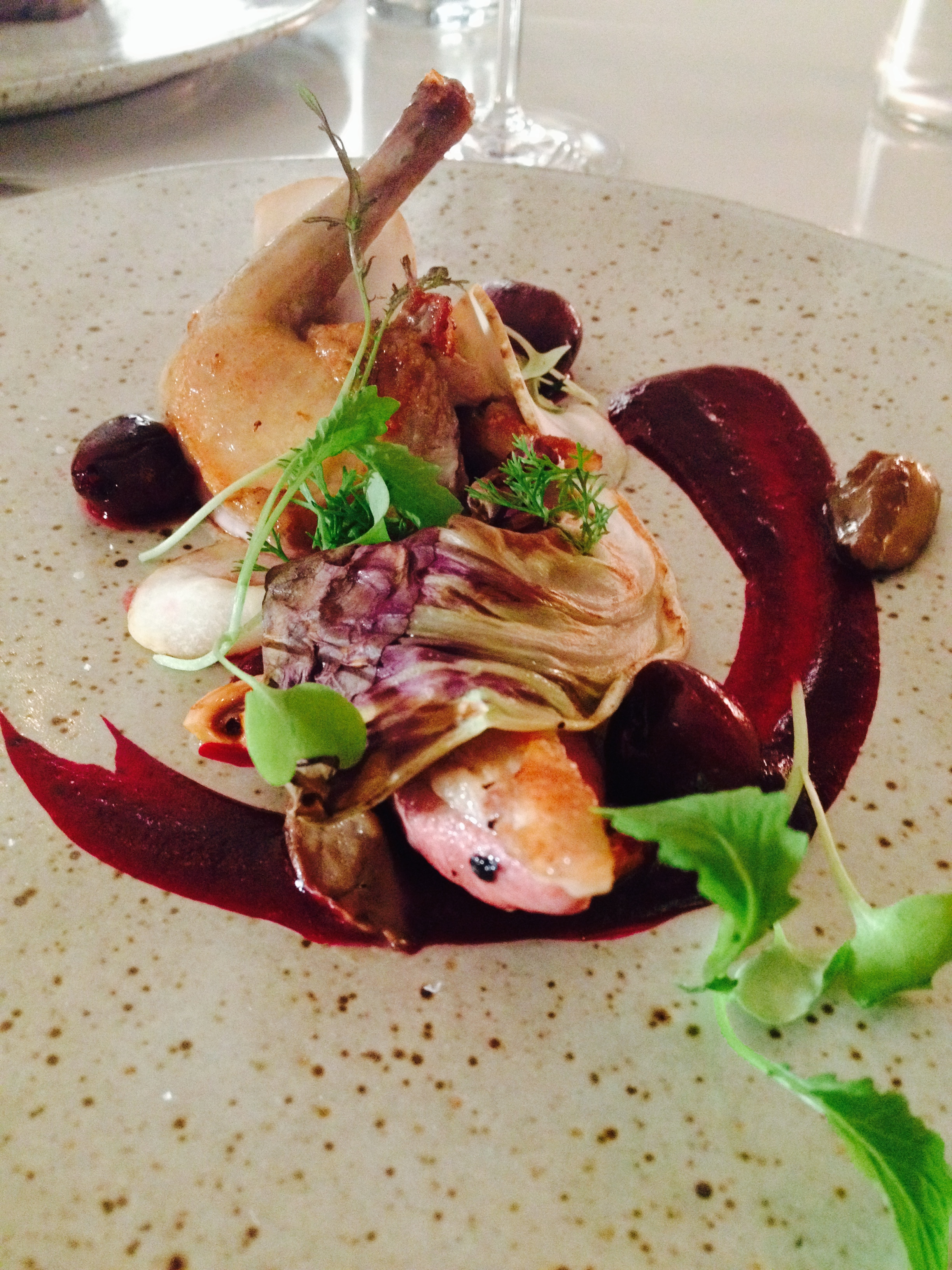Pigeon with cherry, porcini mushrooms, and hazelnuts.