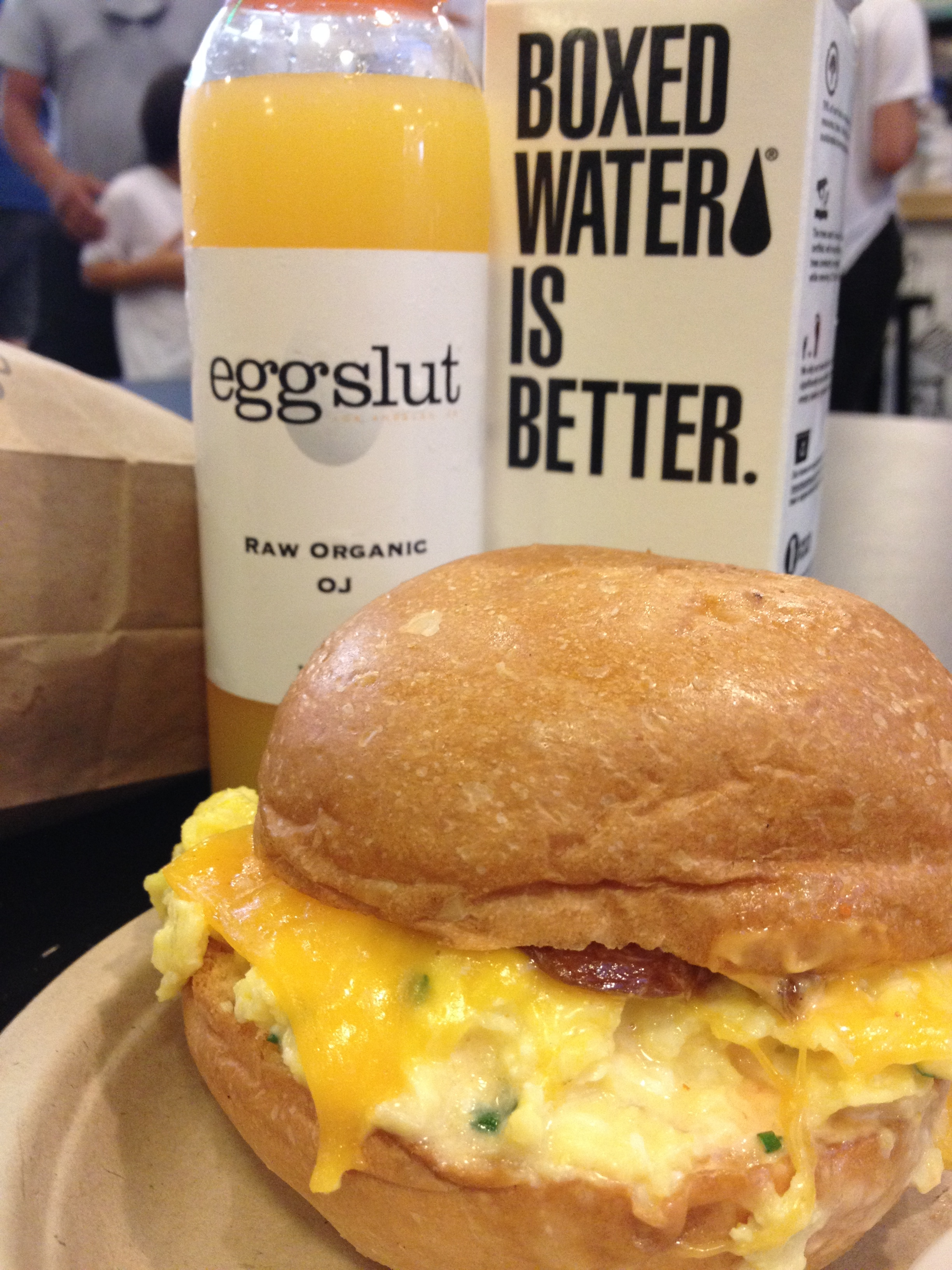 The Fairfax - soft scrambled eggs, chives, cheddar cheese, caramelized onions and Sriracha mayo in a warm Portuguese bun.