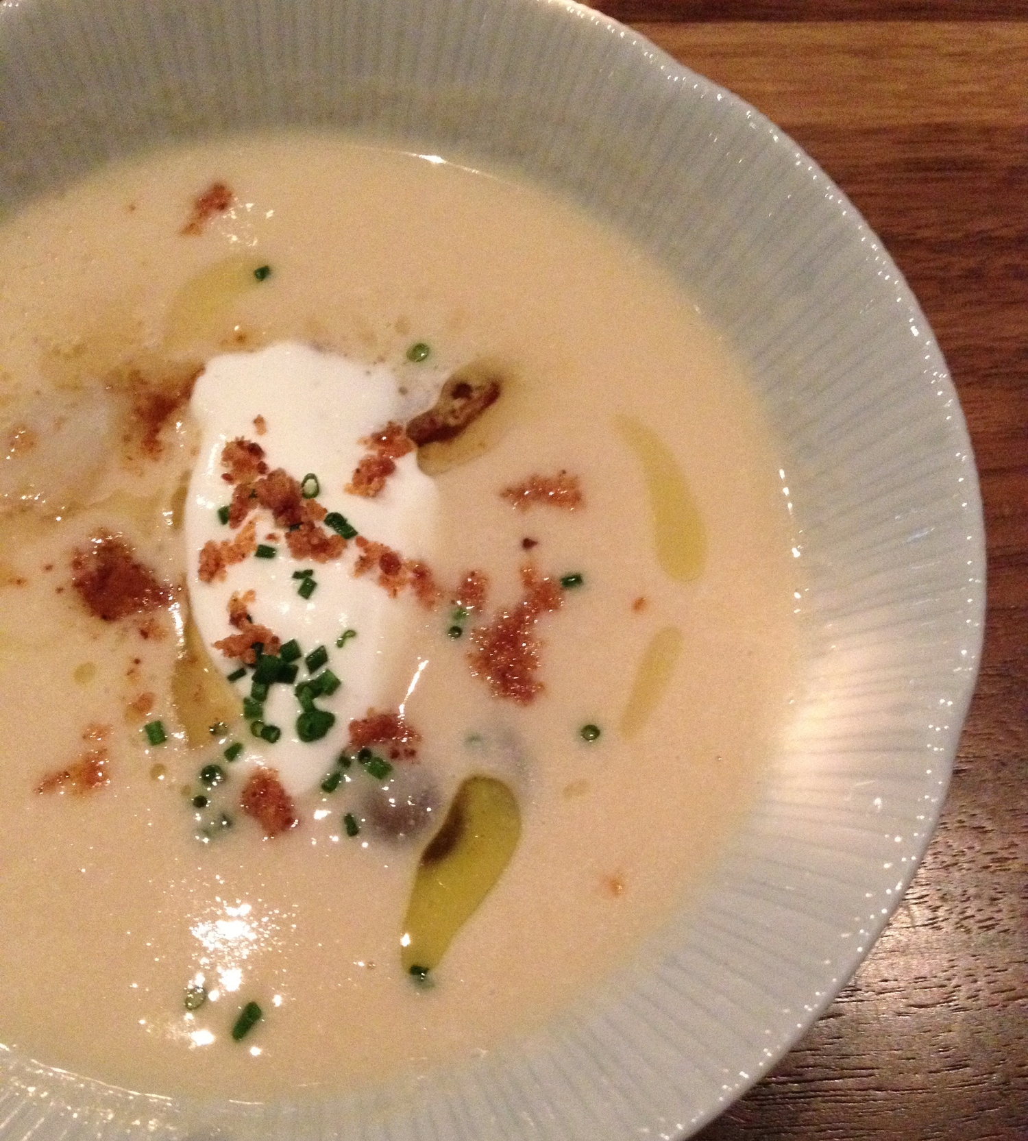 Caramelized onion soup with house made  crème  fraiche, pickled grapes, and diver scallops