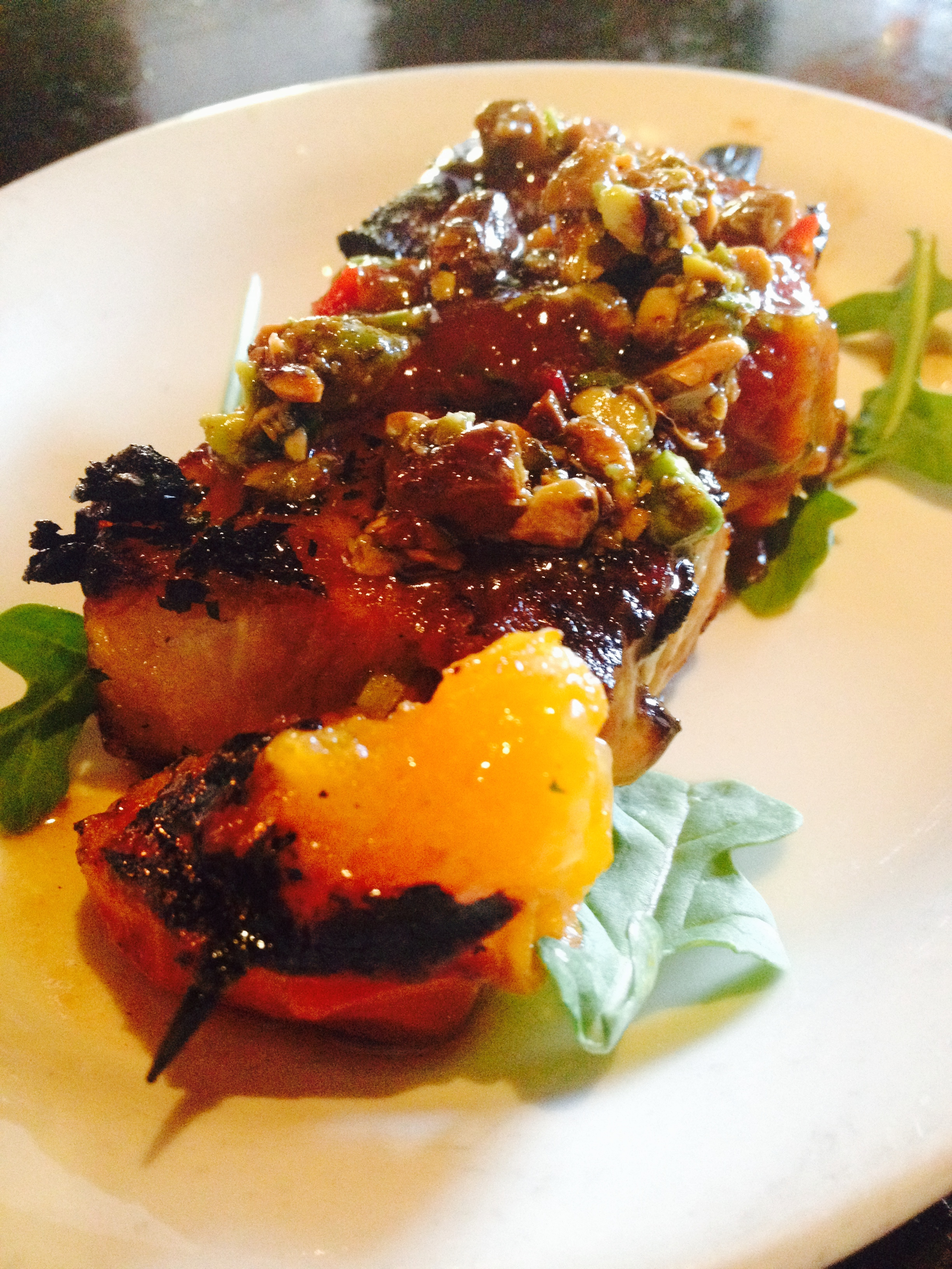 Grilled Pork Belly & Apricot Skewer with spicy apricot chutney and pistachios.