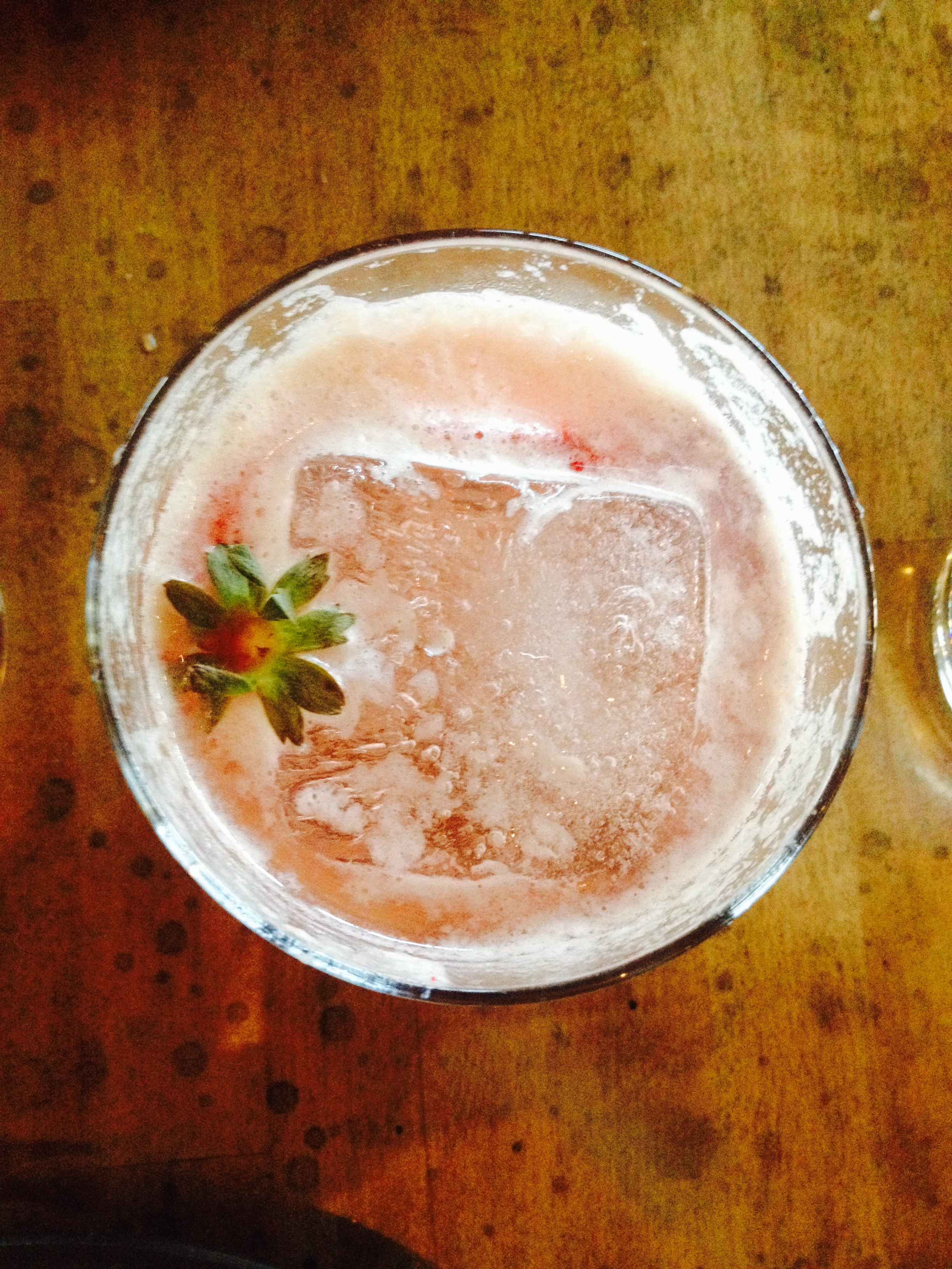 Tequila cocktail with, strawberry, rose water, sherry, verjus, and lambic.