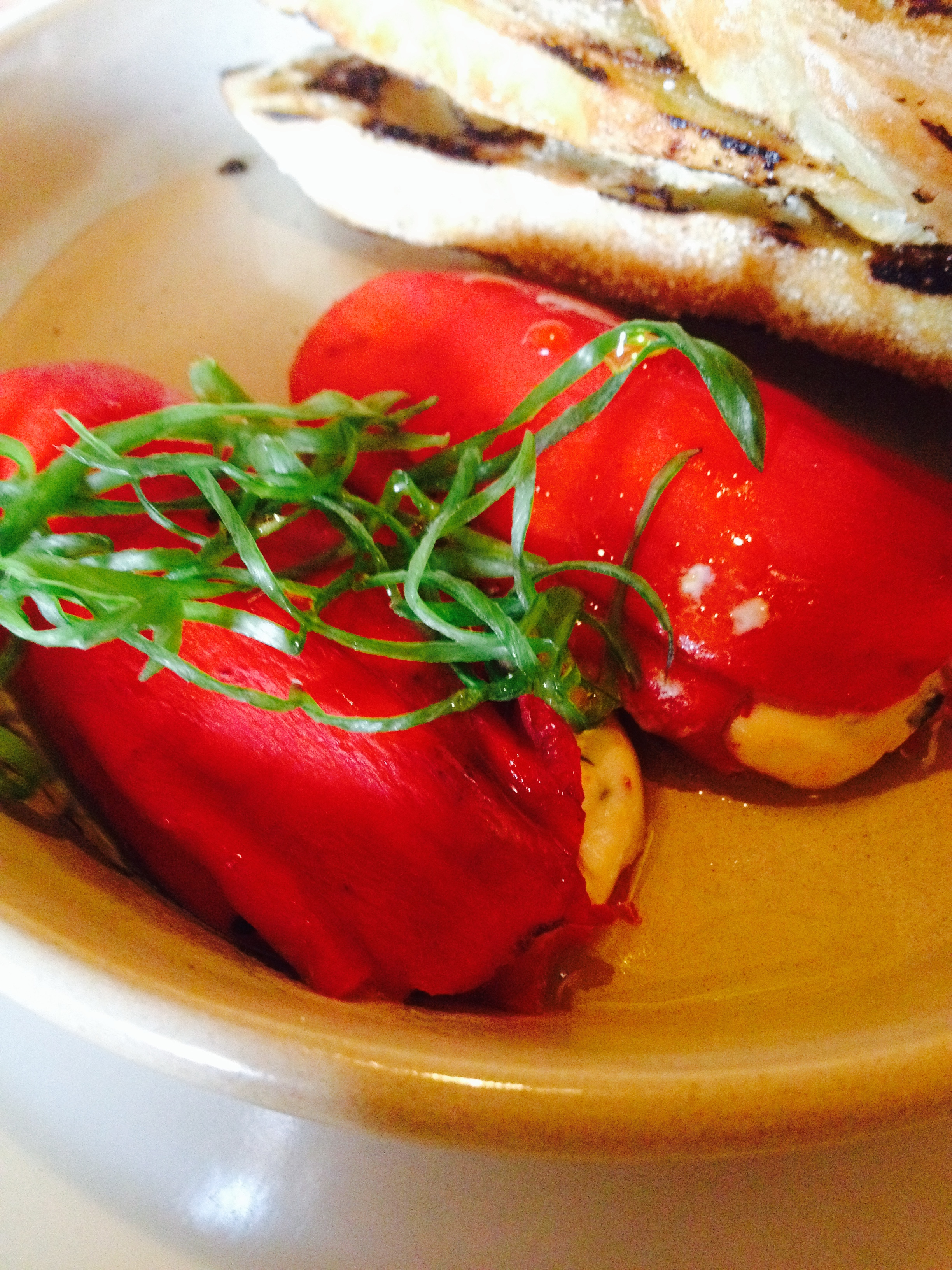 Stuffed Piquillo Peppers with herbed Spanish goat cheese and grilled bread.