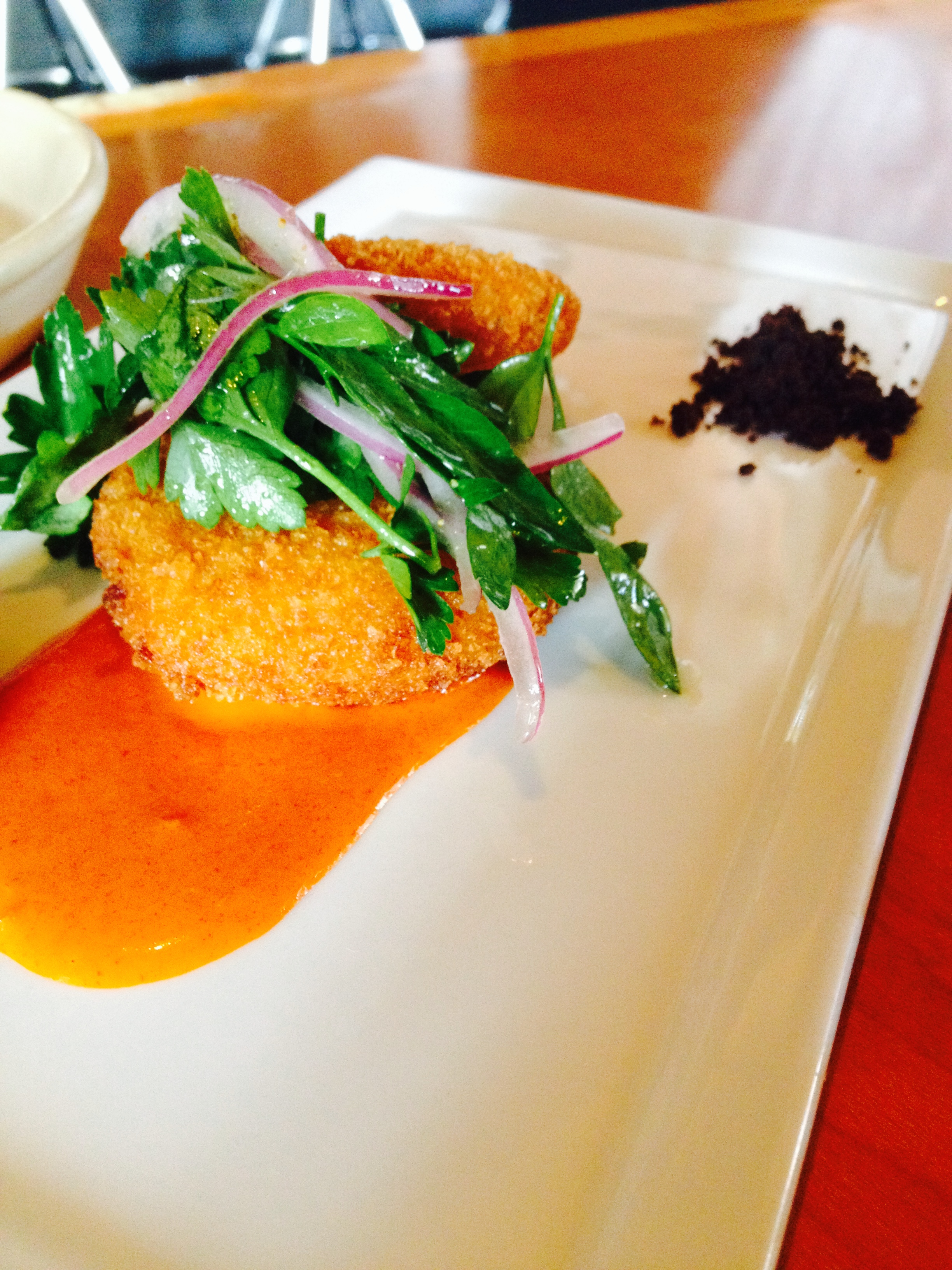 "Salt Cod Brandade Fritters with piquillo gastrique, pimento aioli, and olive ""soil."""