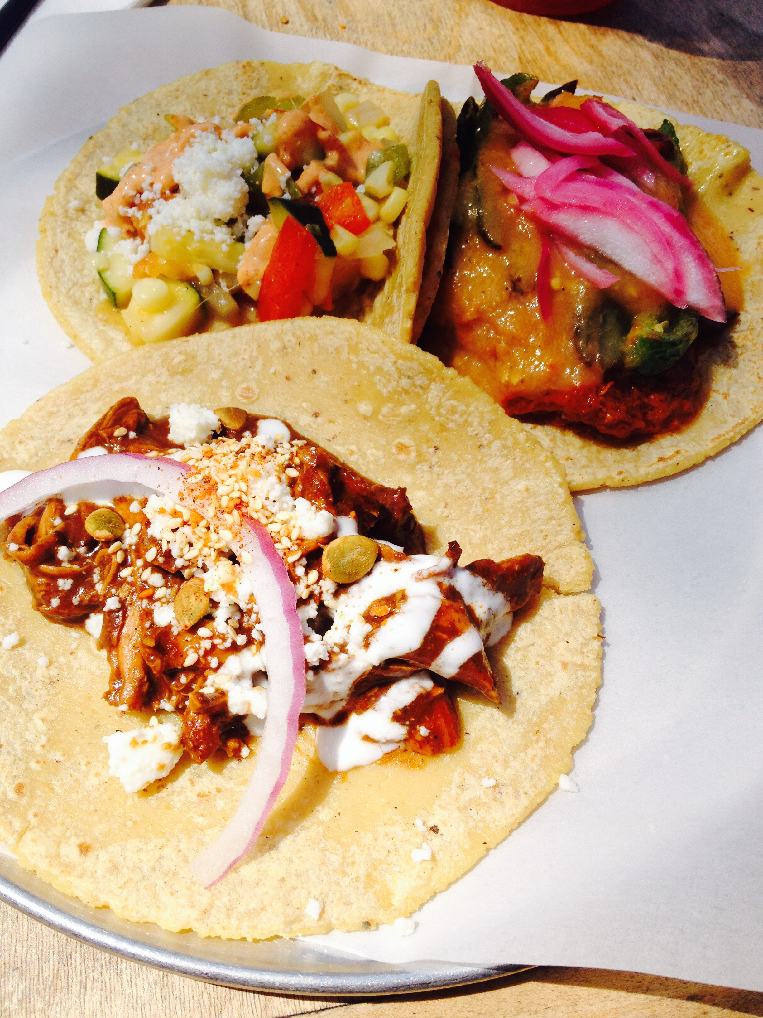 Mole Poblano     (front).    Cochinita Pibil    served at level 10 (it's offered from levels 1-10) with   shredded pork cooked in achiote peppers on top of black beans, served with pickled onions and habanero chilies.    Calabasitas    with squash, tomatoes, bell peppers, corn and onions. Served with queso fresco and a mild chipotle-sour cream.