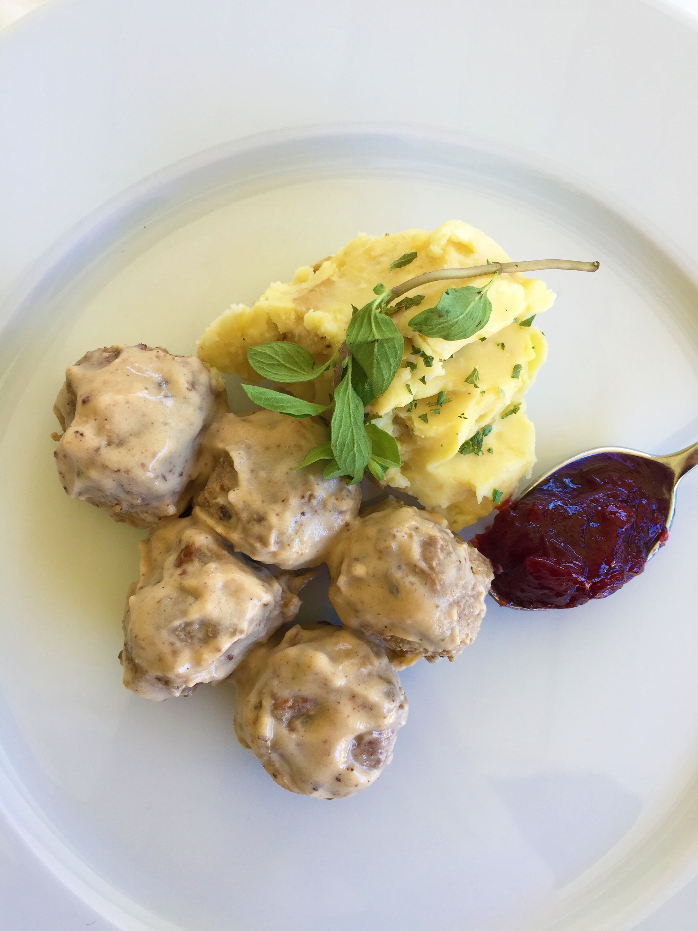 Traditional plating with mashed potatoes and lingonberries.