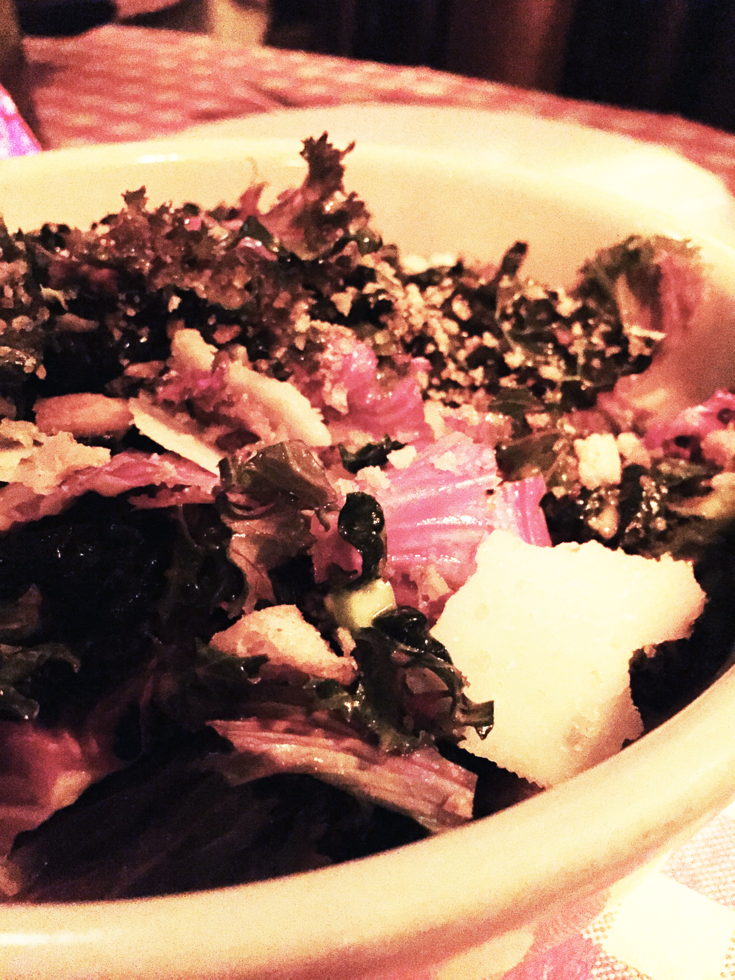 Kale Caesar with Tuscan and Red Russian kale, parmigaiano, garlic, croutons, and anchovy-caesar dressing.