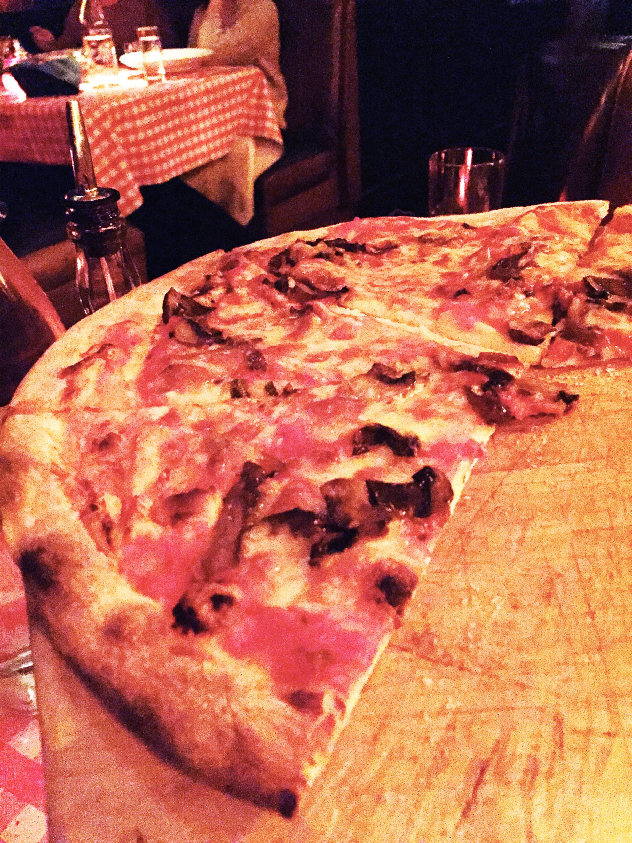 Funghi Pizza with San Marzano tomato sauce, mozzarella, and seasonal mushrooms.