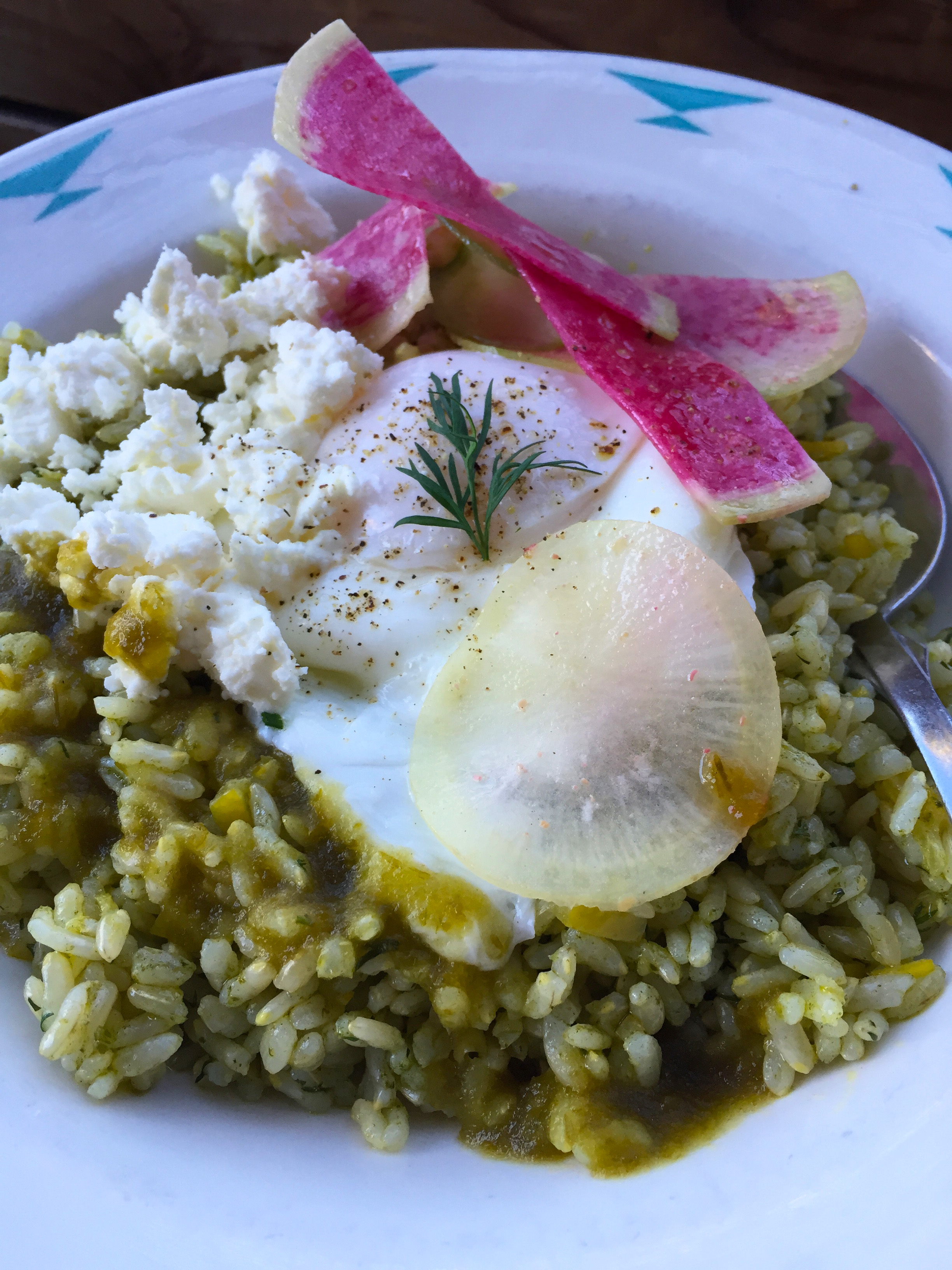 Sorrel Pesto Rice Bowl with Kokohu Rose Brown Rice, nut-free Sorrel Pesto, Preserved Meyer Lemon, Lacto Fermented Hot Sauce, Black Radish, French Sheep Feta, and a Poached Egg.