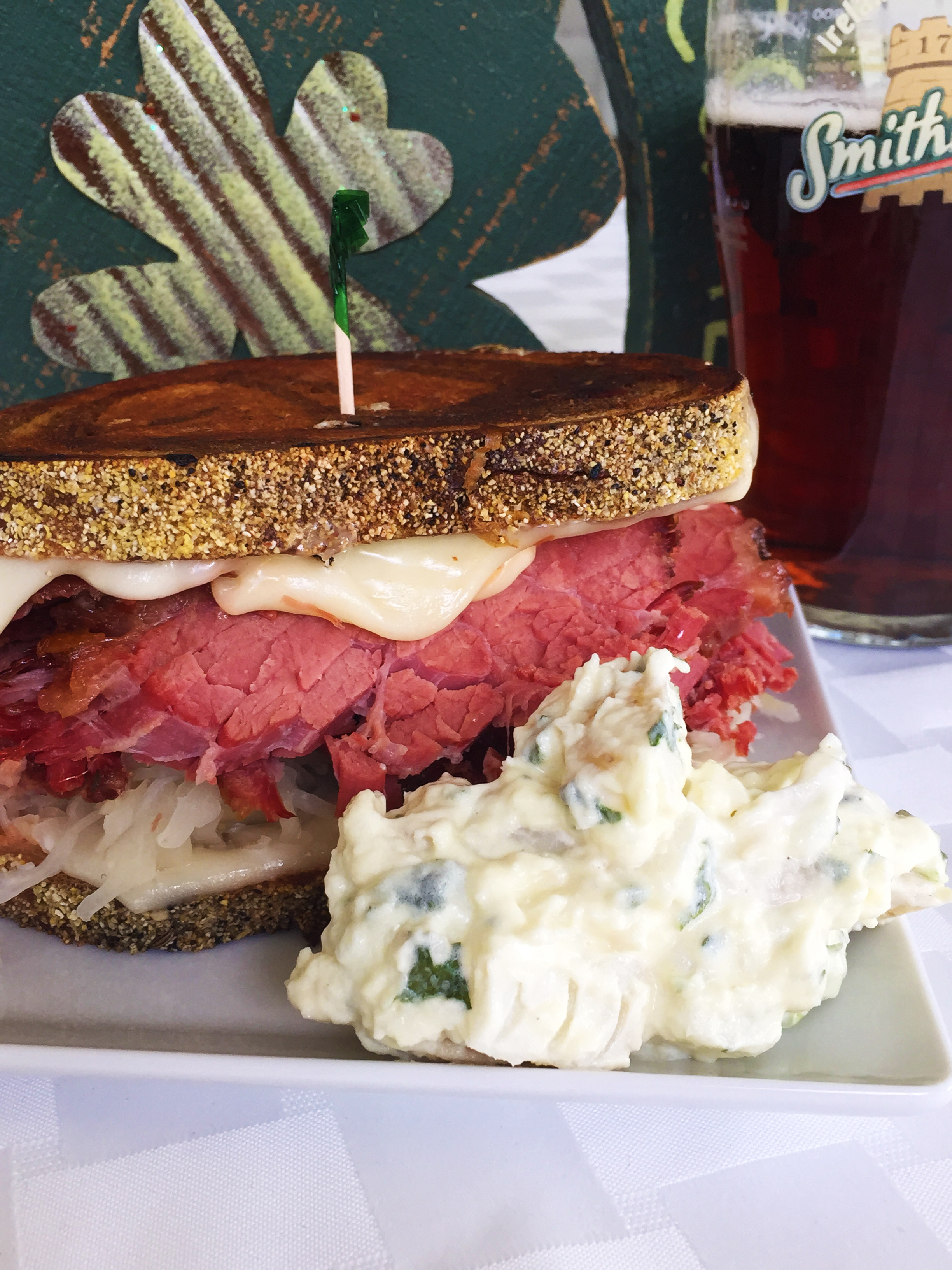 Corned Beef Reuben on marble rye with Russian dressing, Swiss cheese, and Boar's Head sauerkraut.