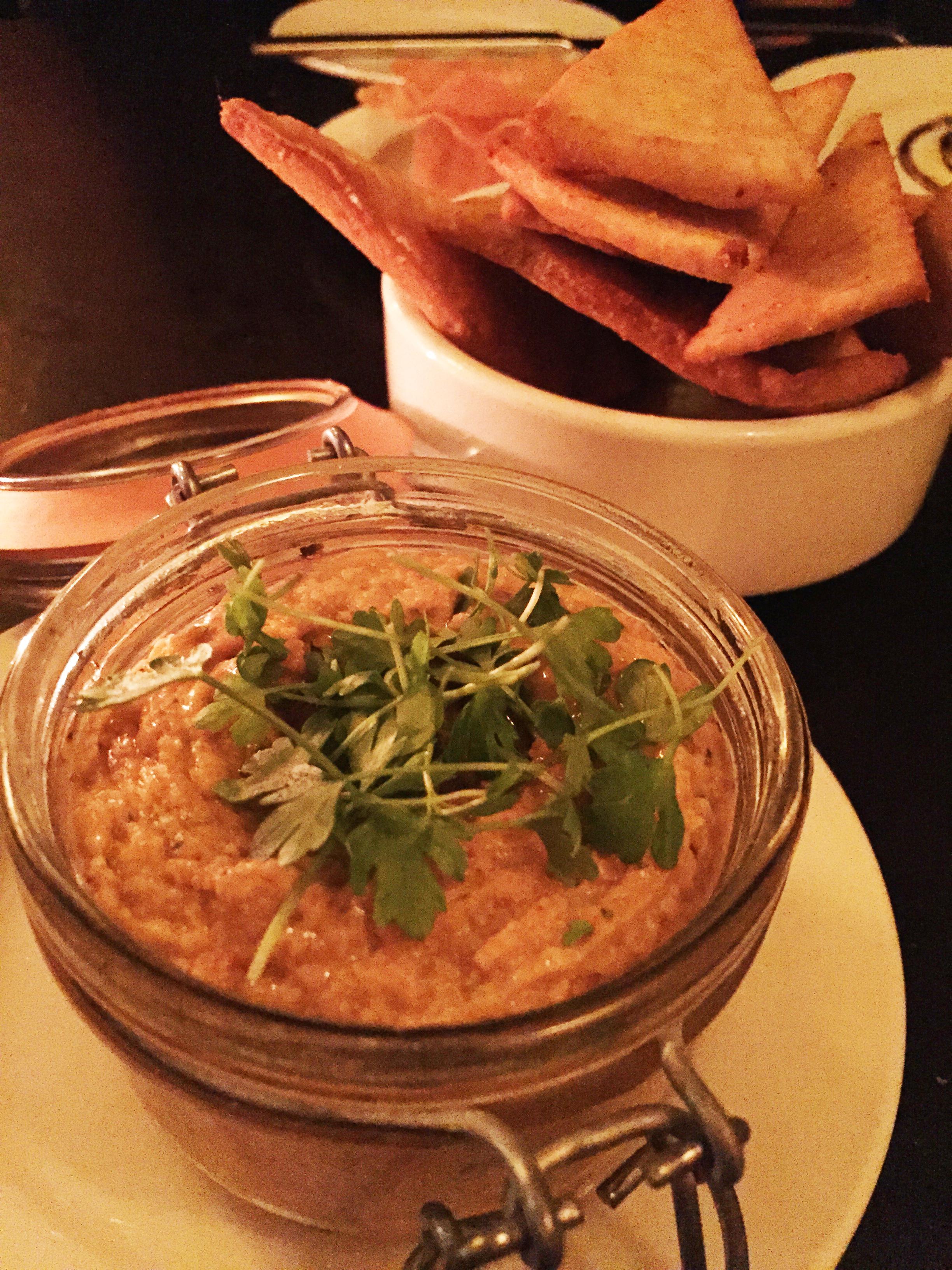Chipotle Hummus with smoked paprika pita crisps.