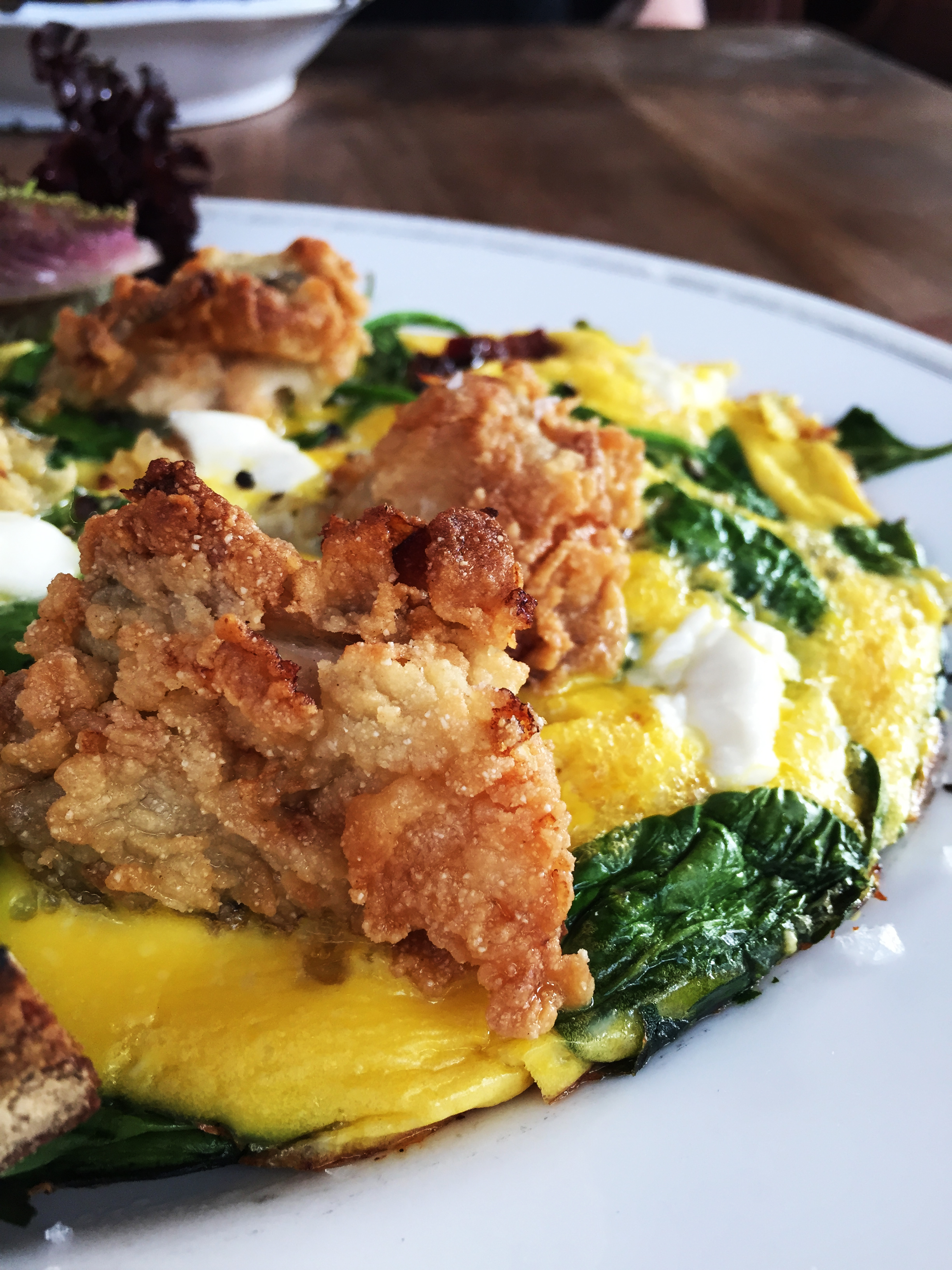 Fried Oyster Frittata with Spinach and Bacon.