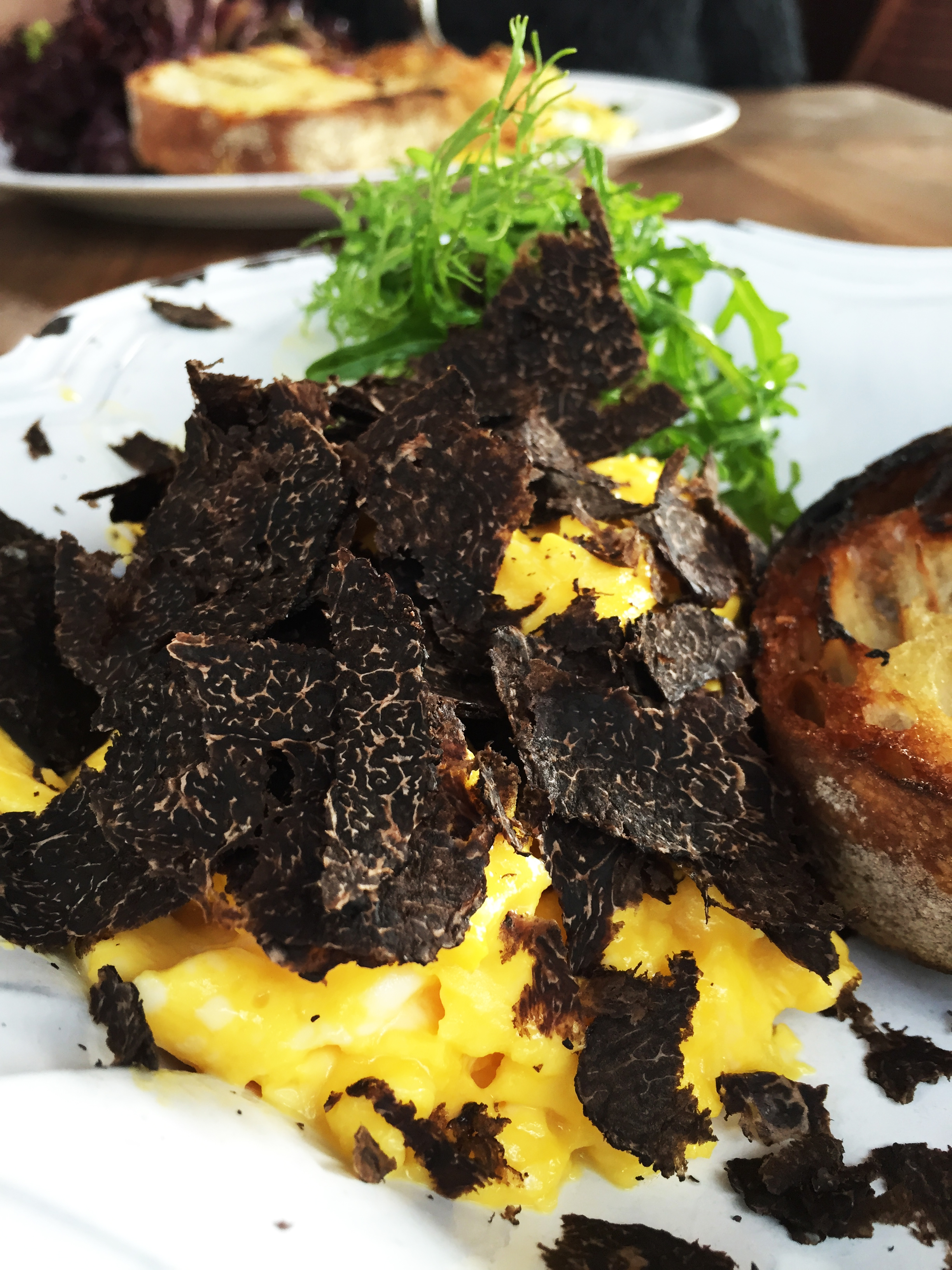 Scrambled eggs with Perigord Truffles, served with Champagne  (on the menu back in March during truffle season) .