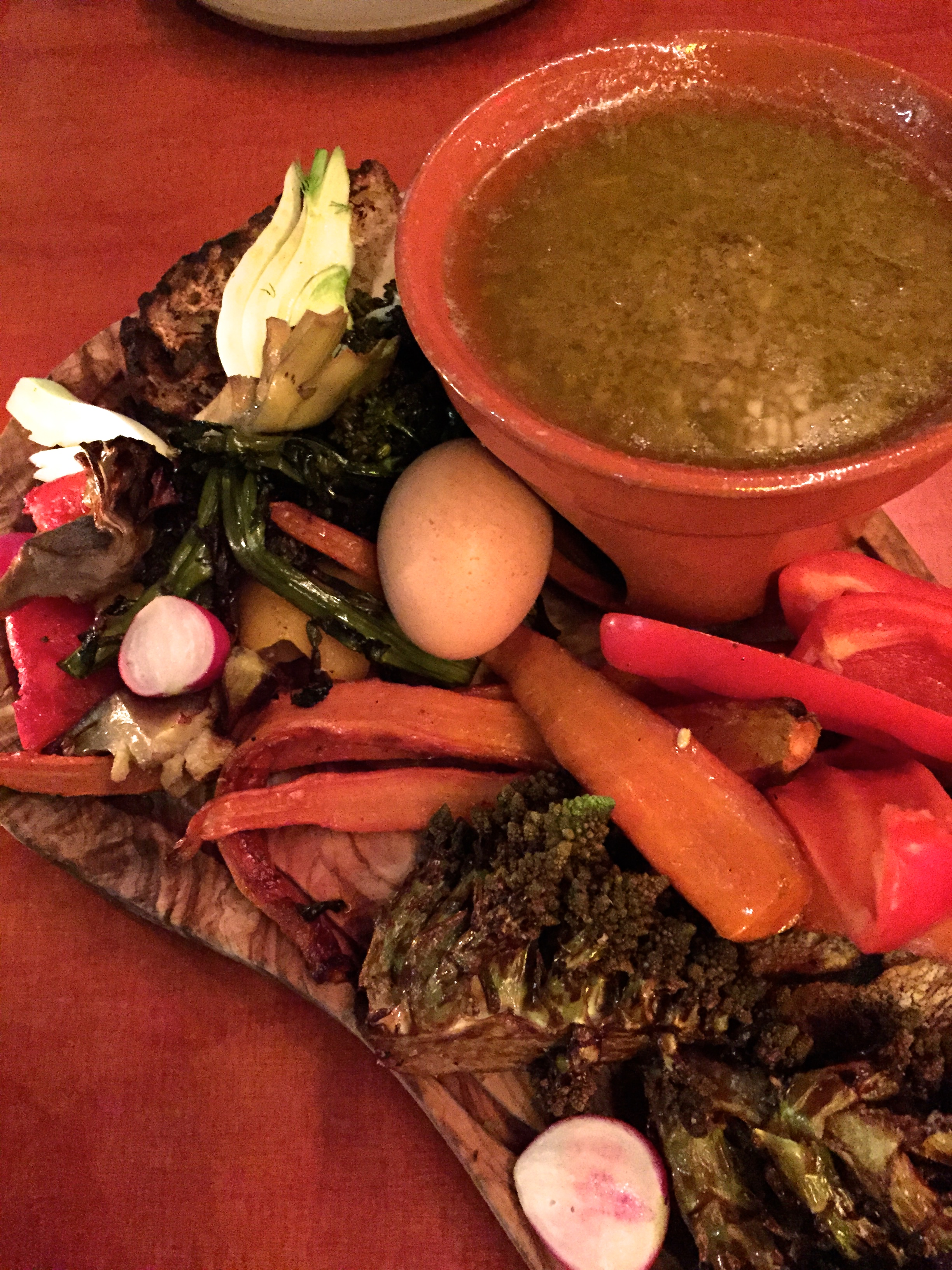 Bagna Caoda DOP with bread, vegetables, and a soft-boiled egg.