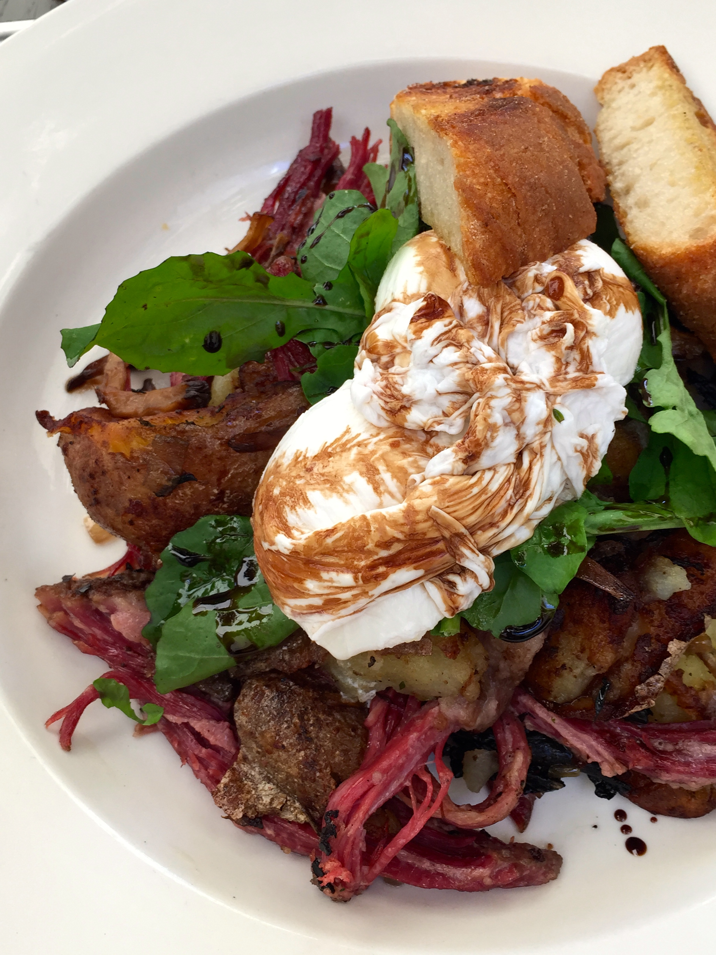 House-made corned beef hash wild mushrooms & poached eggs.