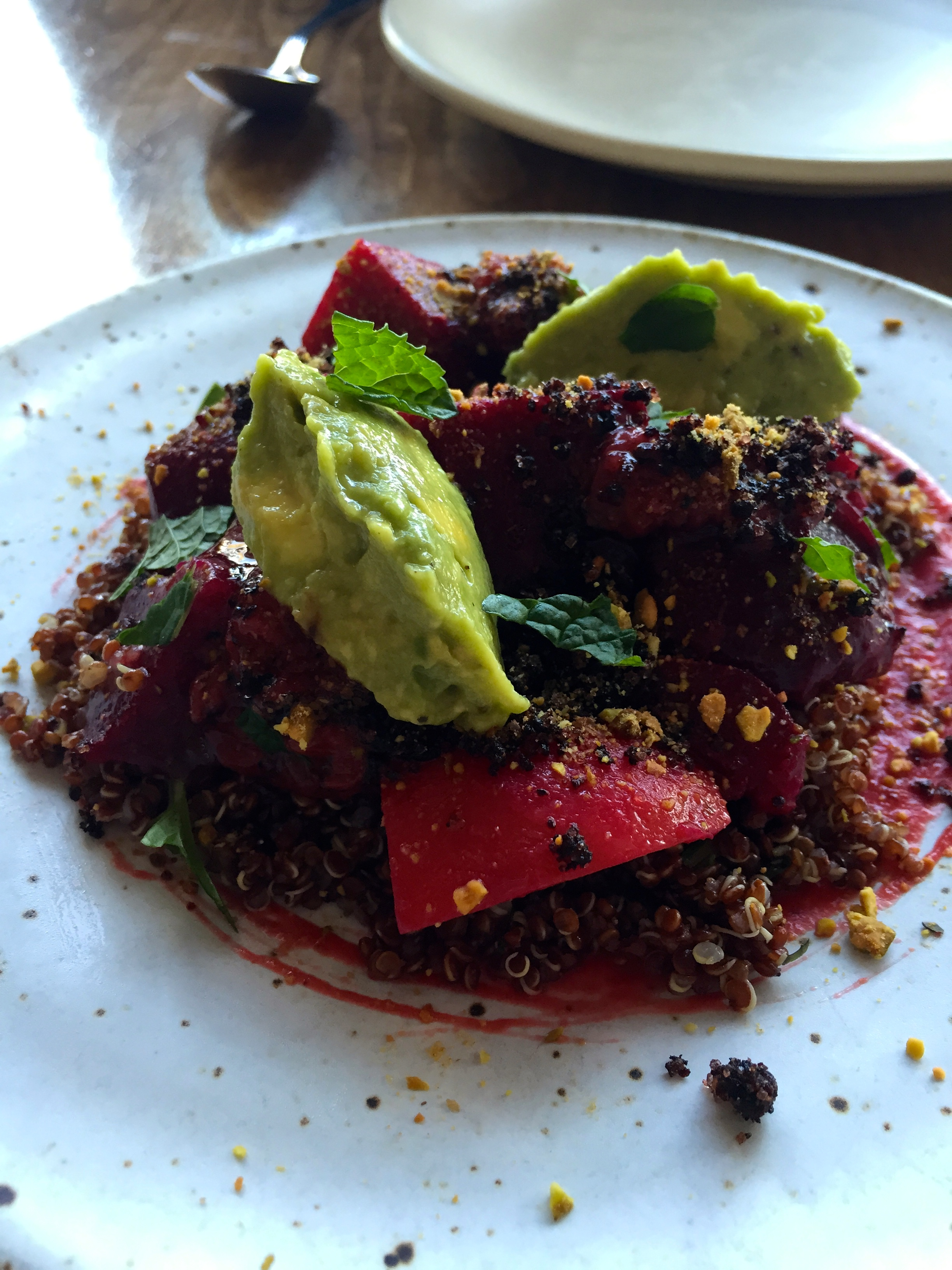 "Beets and charred strawberry jjlone daughter's 'sir prize' avocado, rancho gordo red quinoa, and pistachio ""soil."""