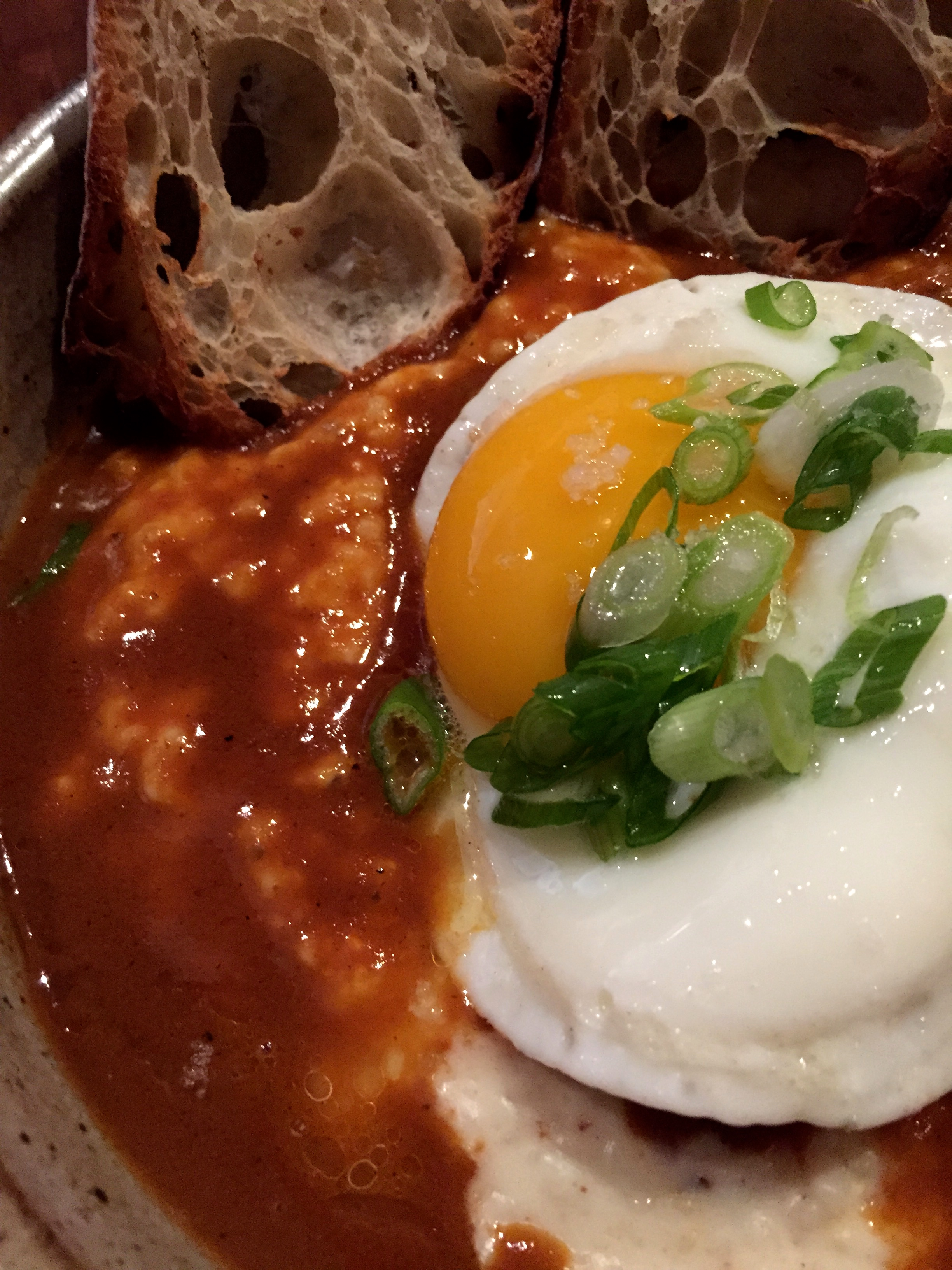 Shrimp and cheddar grits, chipotle, a fried egg, and toast.