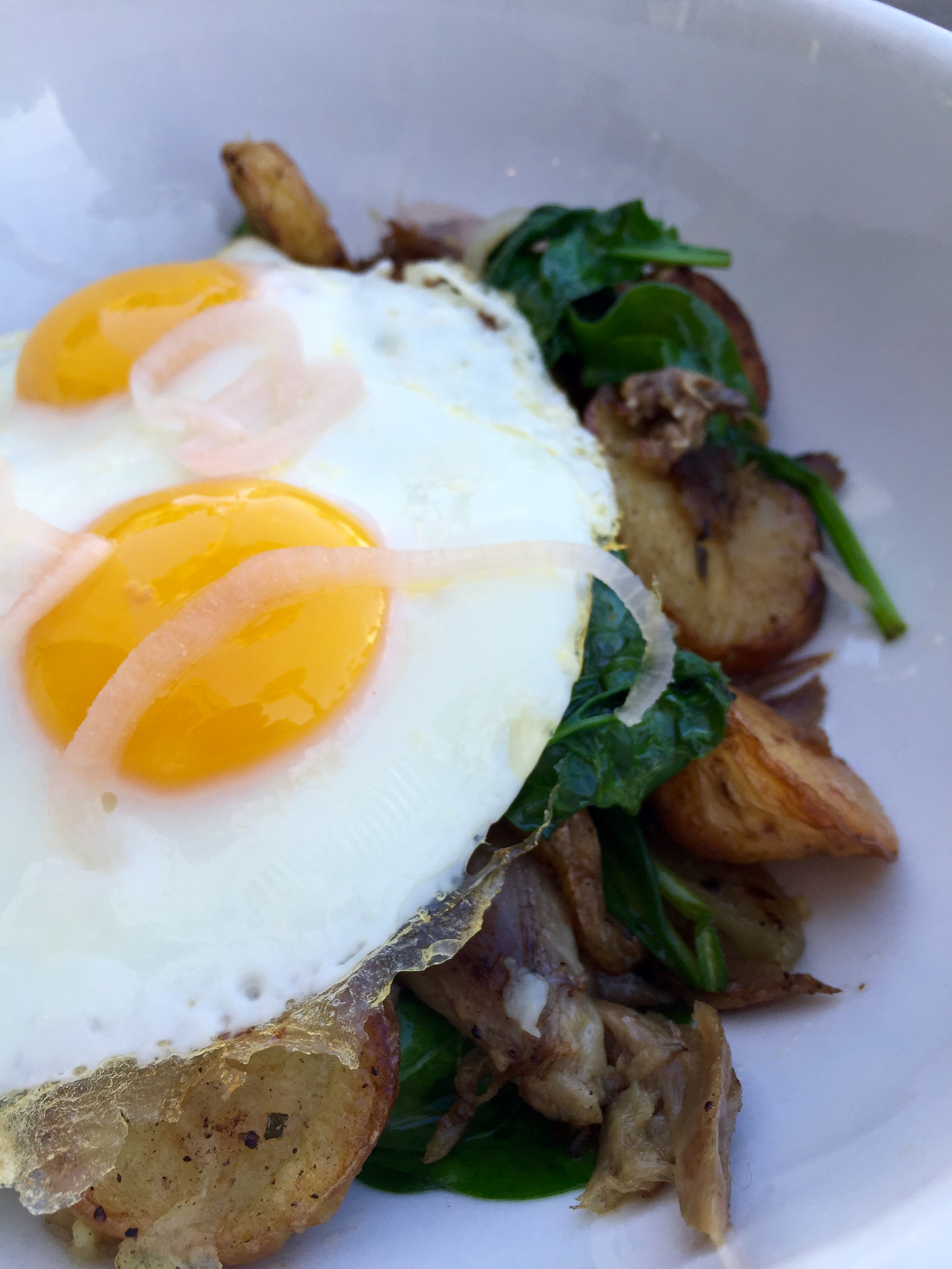 Duck Confit hash with Weiser Farm's roasted potatoes, shallots, spinach & sunny-side up eggs.