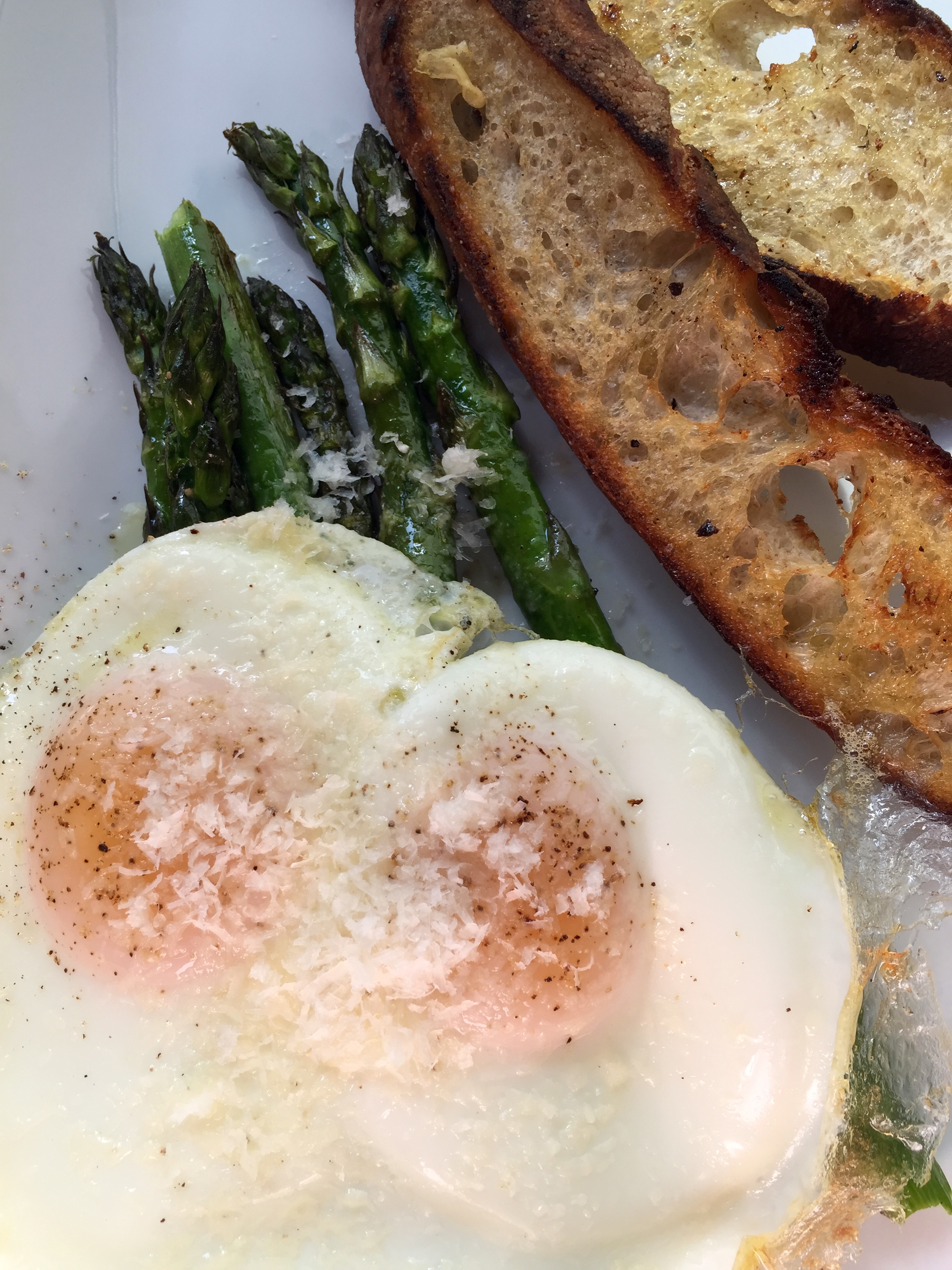 WOOD-FIRED ASPARAGUS - sunny-side up eggs, parmesan, toasted baguette, and lemon.