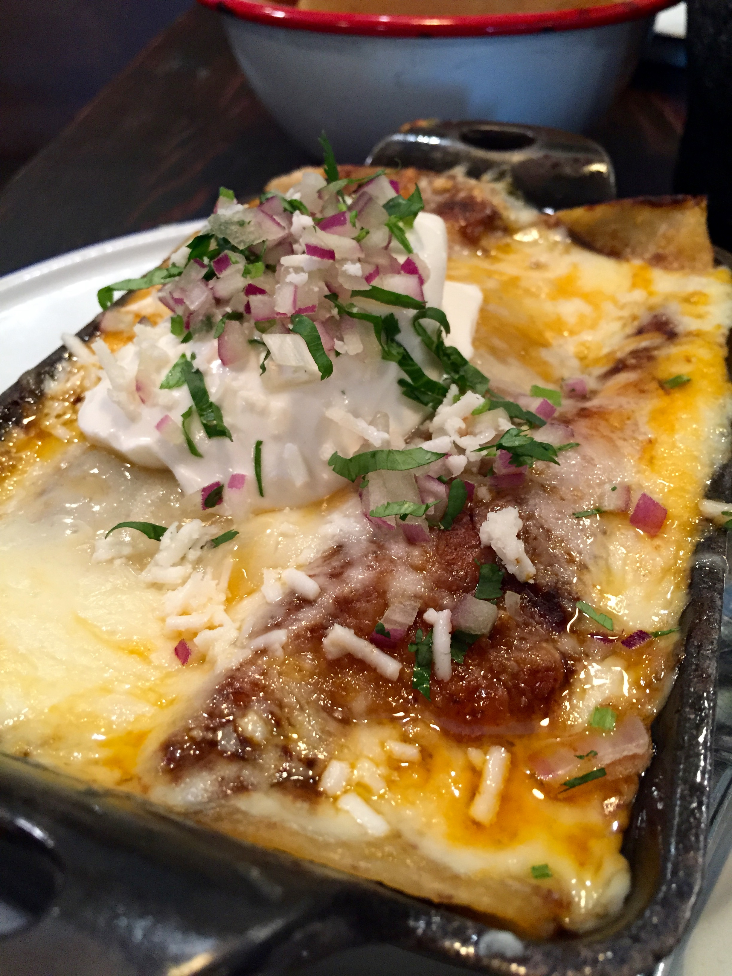 Mole Lengua Enchiladas with monterey jack, cheddar, and onion.