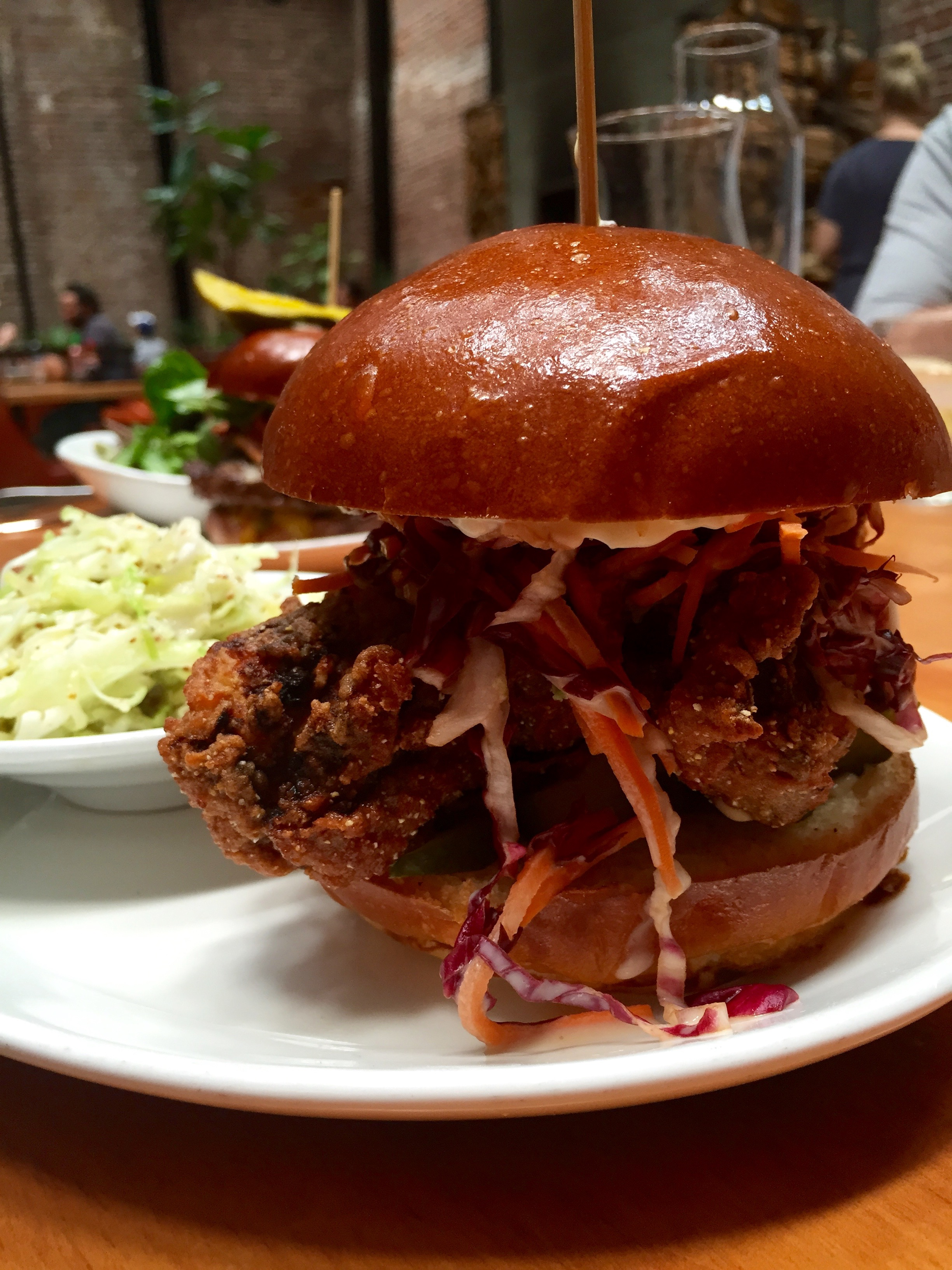 Buttermilk Fried Chicken Sandwich with  radicchio slaw, jalapeno-mustard aioli, and house made pickles.