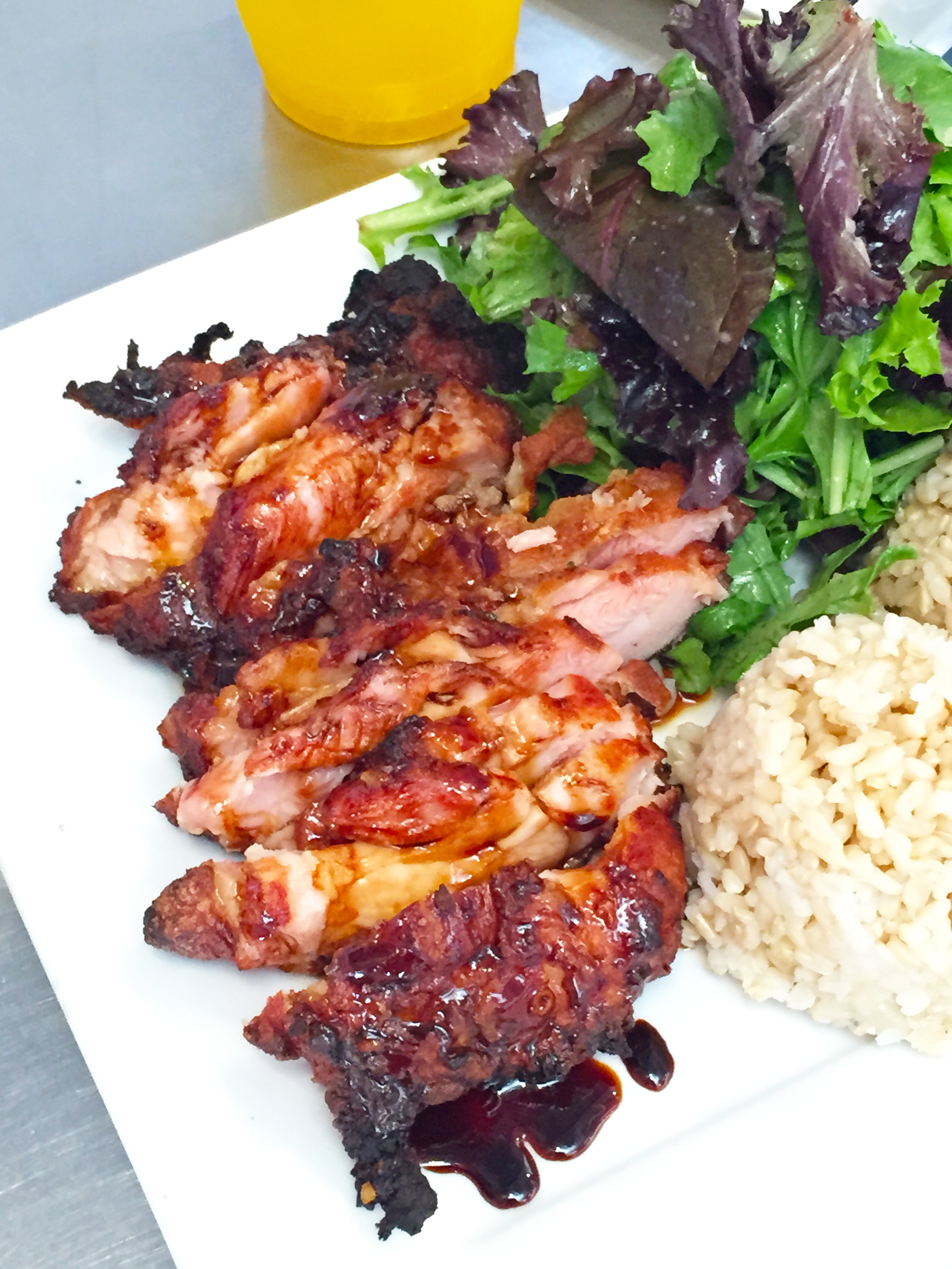 Mochiko Fried Chicken - Hawaiian-style chicken marinated in a homemade wet batter, fried then oven baked. Served with salad and brown rice.