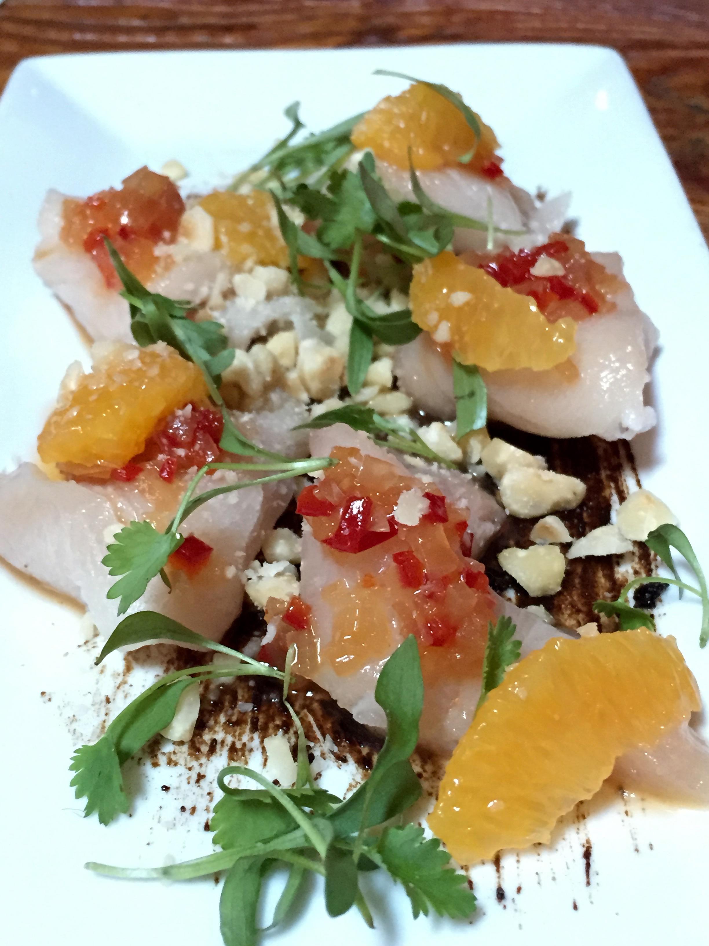 Hamachi with blood orange, black garlic, hazelnuts, cilantro and ginger vinaigrette.