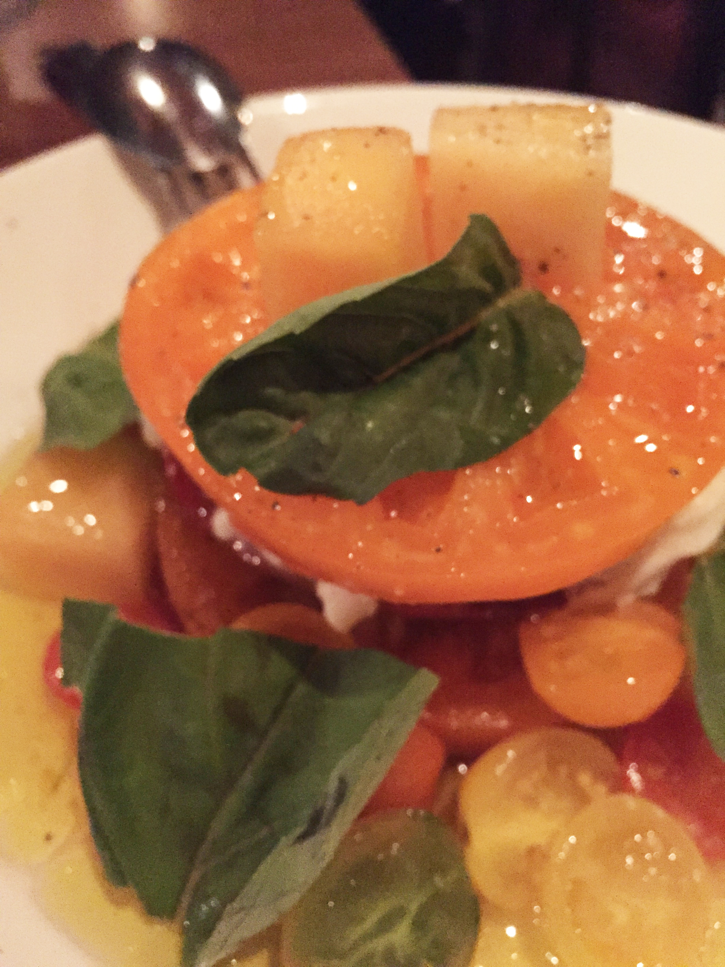 Munak Ranch Heirloom Tomatoes with Gioia burrata, summer melons, and basil.