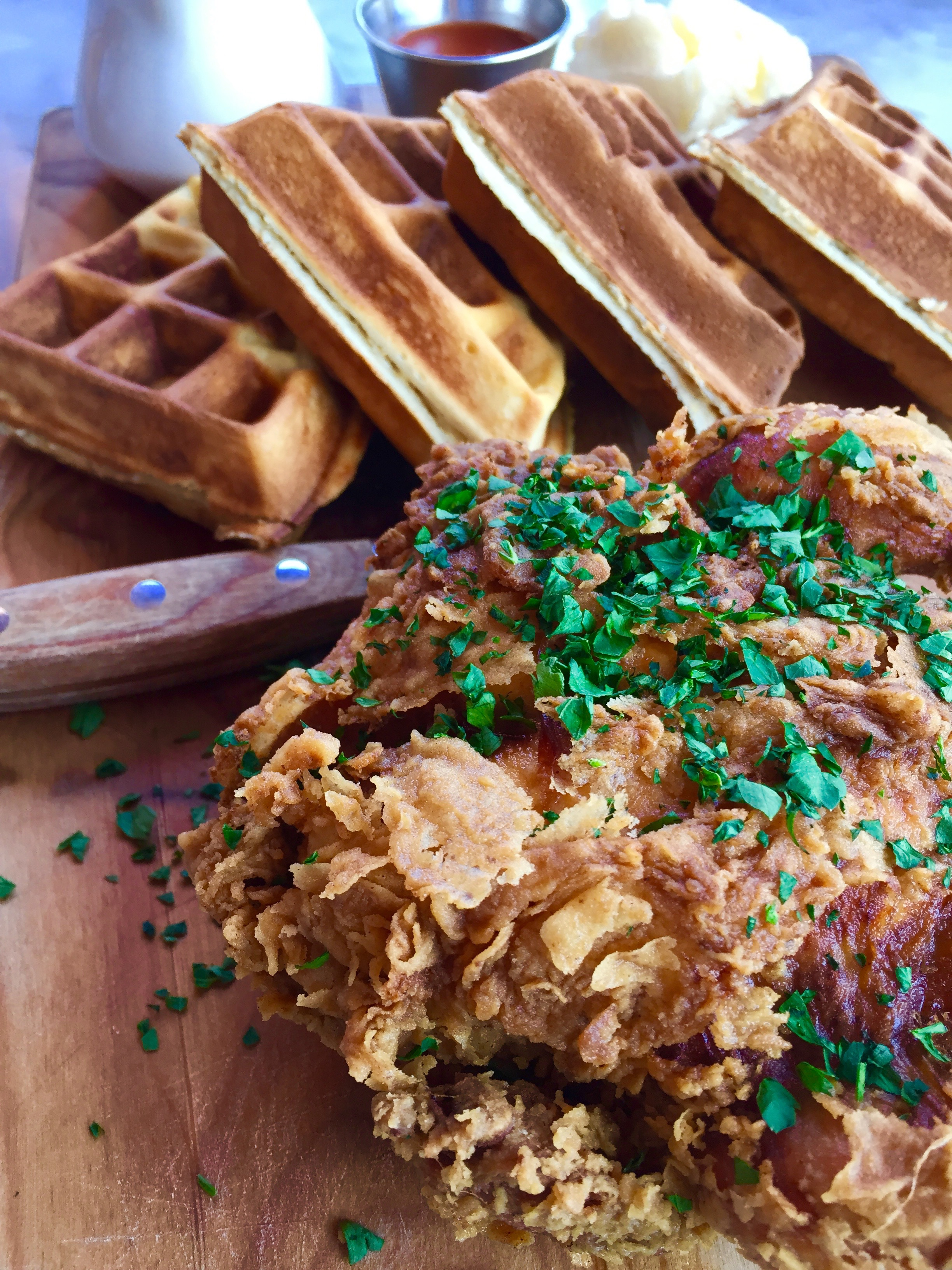 Fried chicken and waffle with maple syrup.