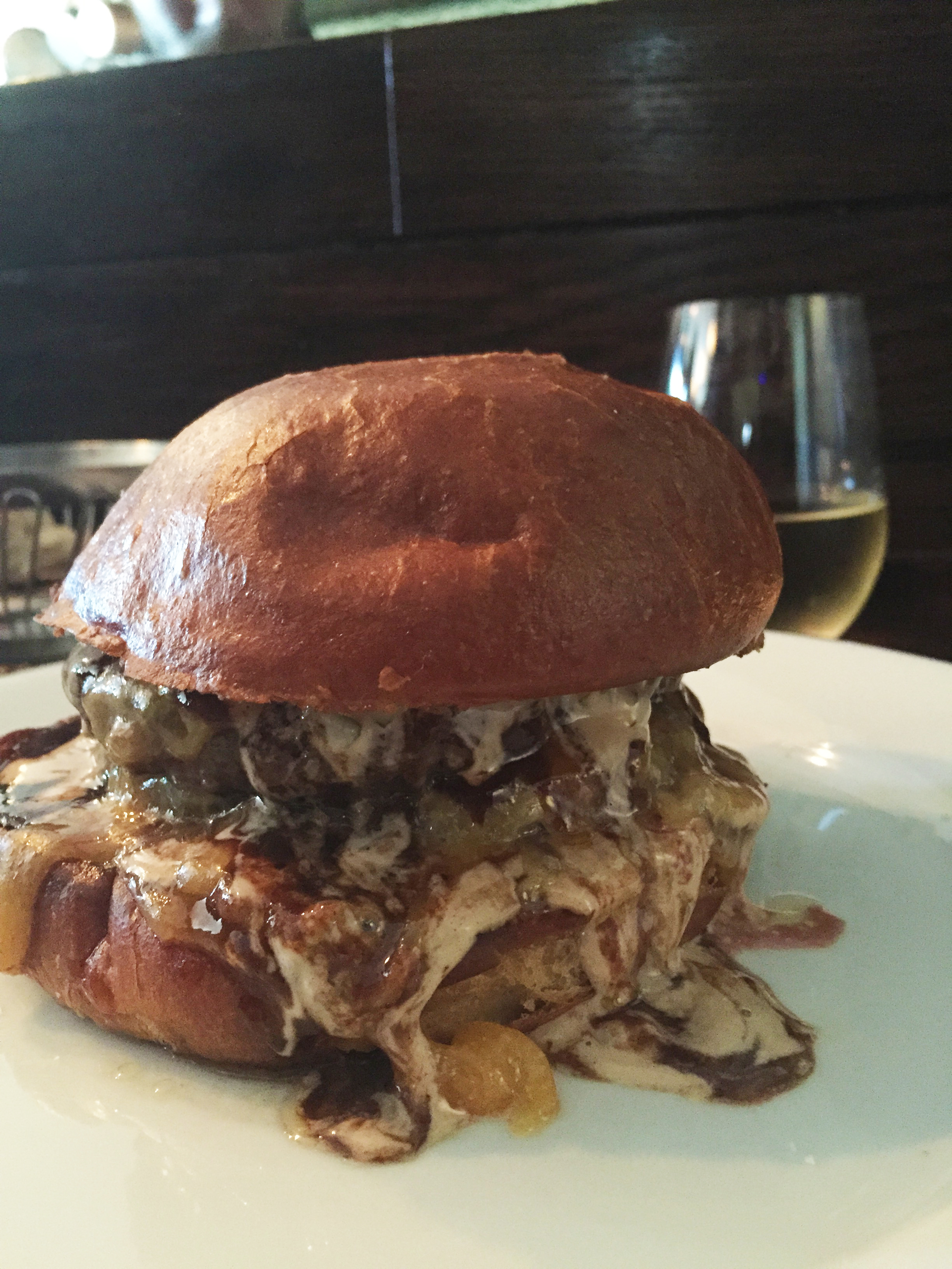 The Big Mec, with two prime beef patties,caramelized onions, garlic aioli, American cheese, and red wine bordelaise.
