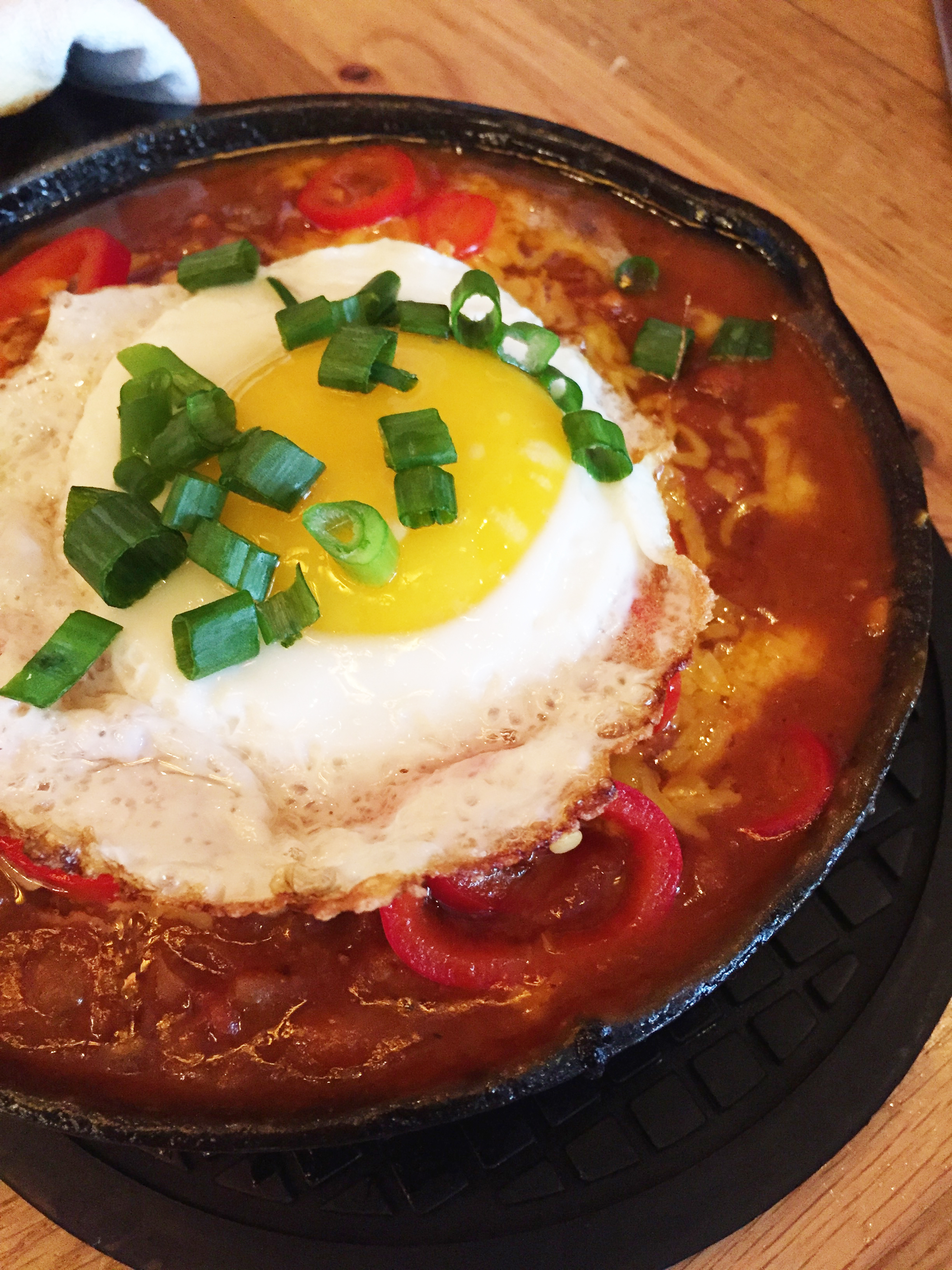 Hangover Hoe Cake with fried egg, chili, cheddar, green onions, and pickled chilies.