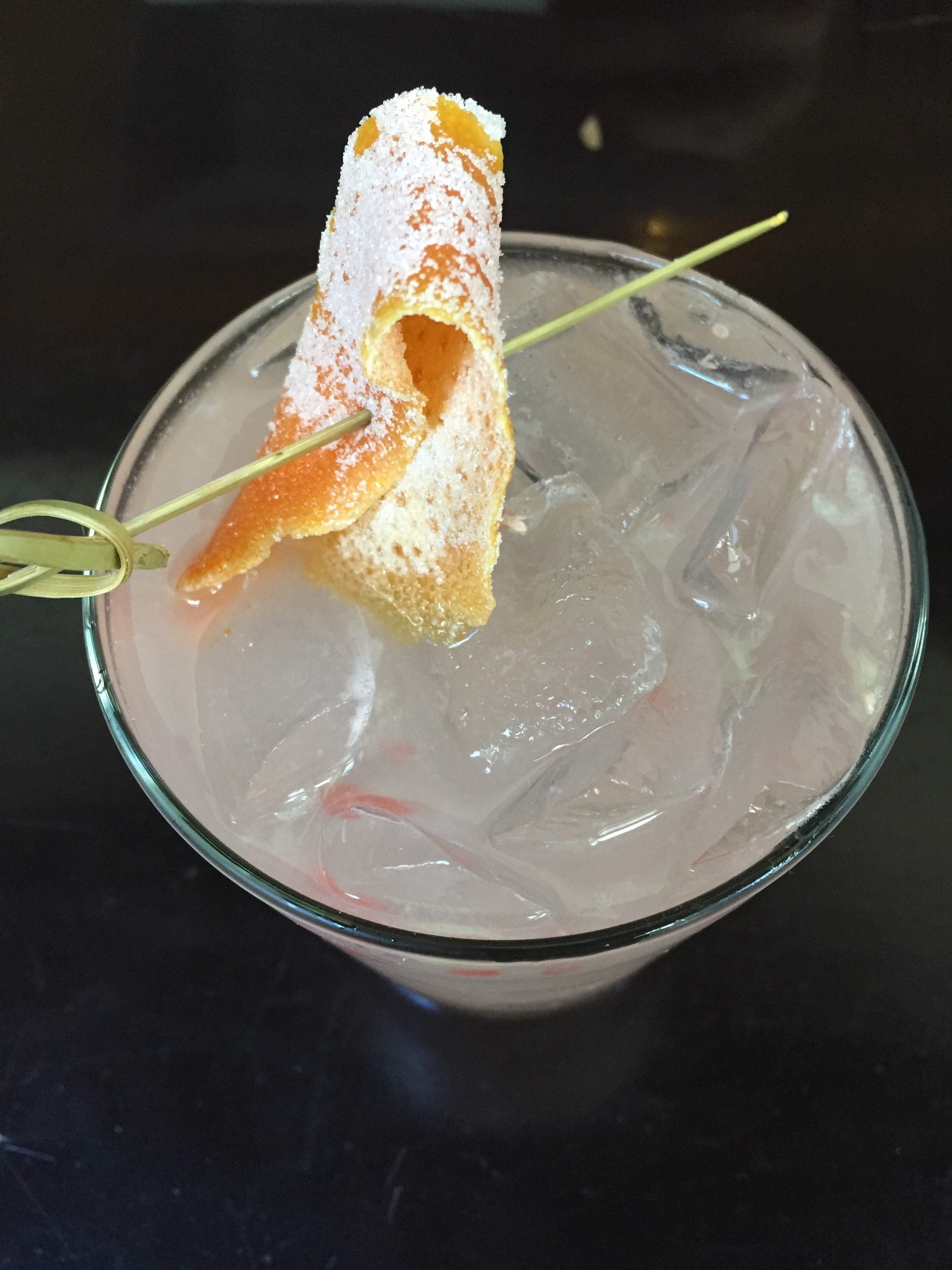 Greyhound Proper with Plymouth Gin, grapefruit, and candied grapefruit peel.