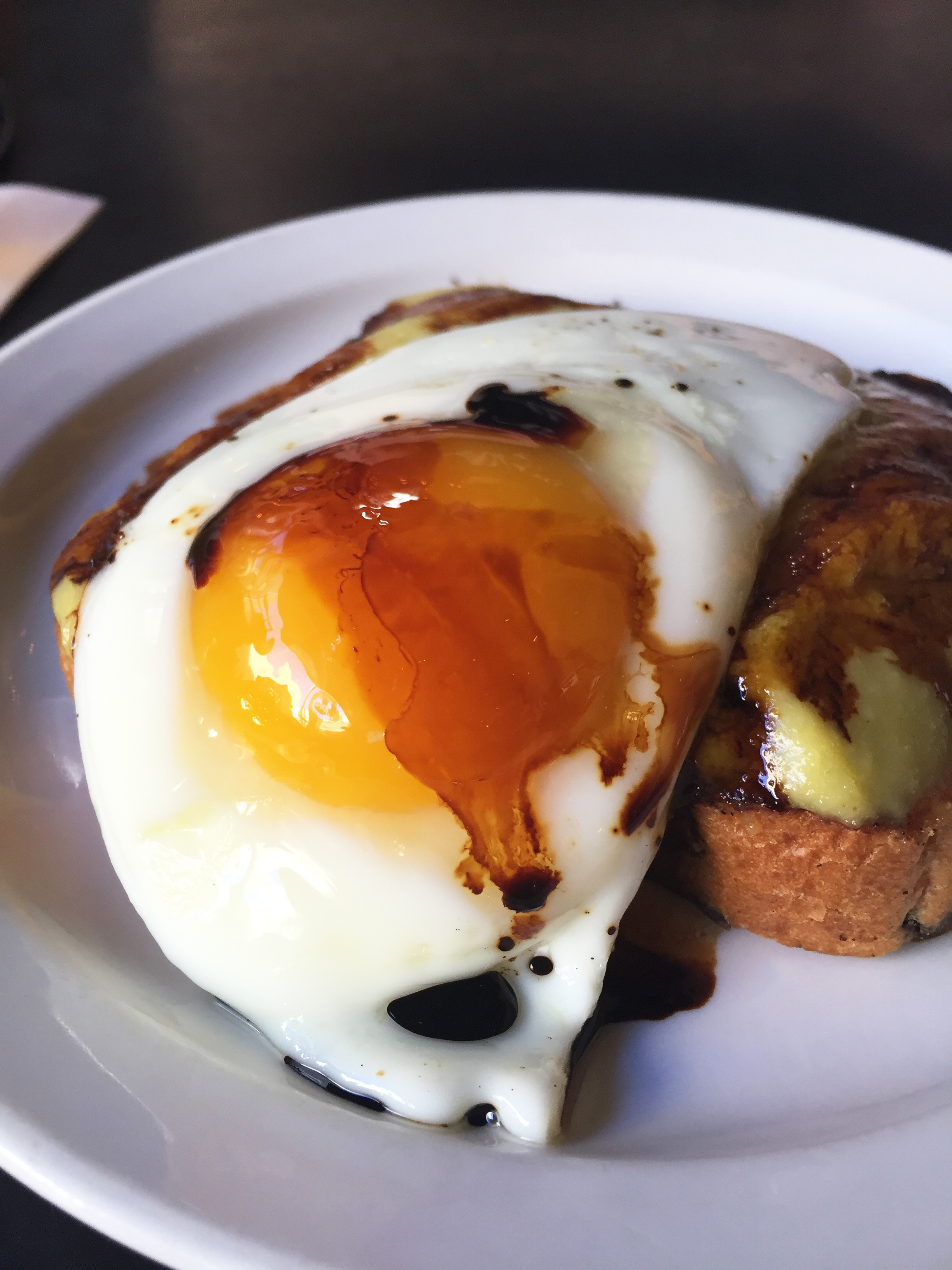 Coconut Kaya Toast with soft egg and dark soy.
