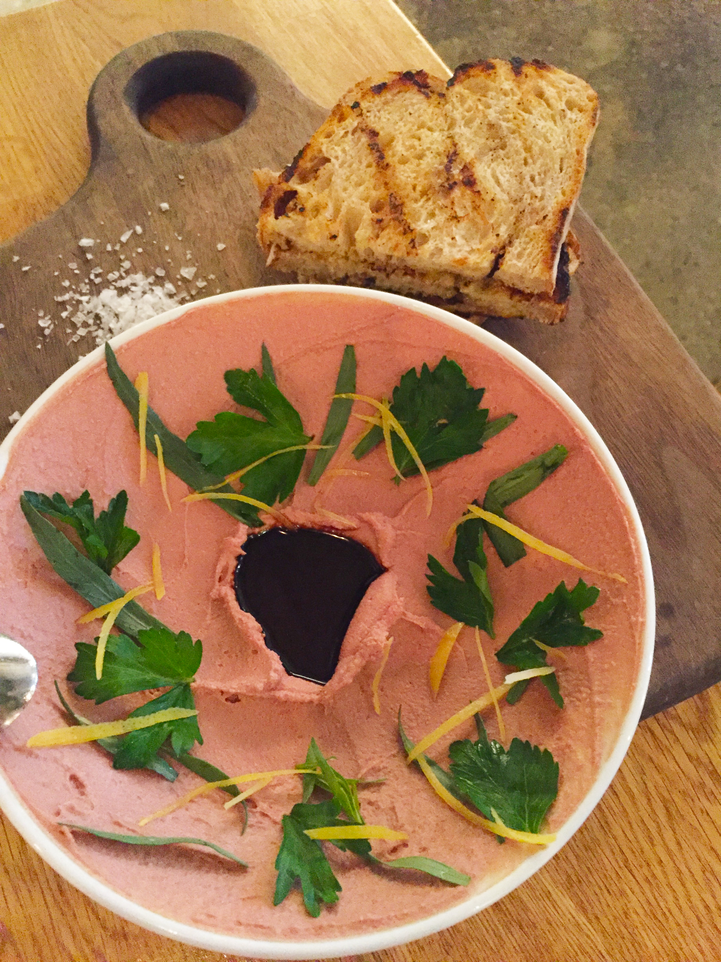 Smoked Chicken Liver Pate with preserved lemon,herb salad, and grilled bread.