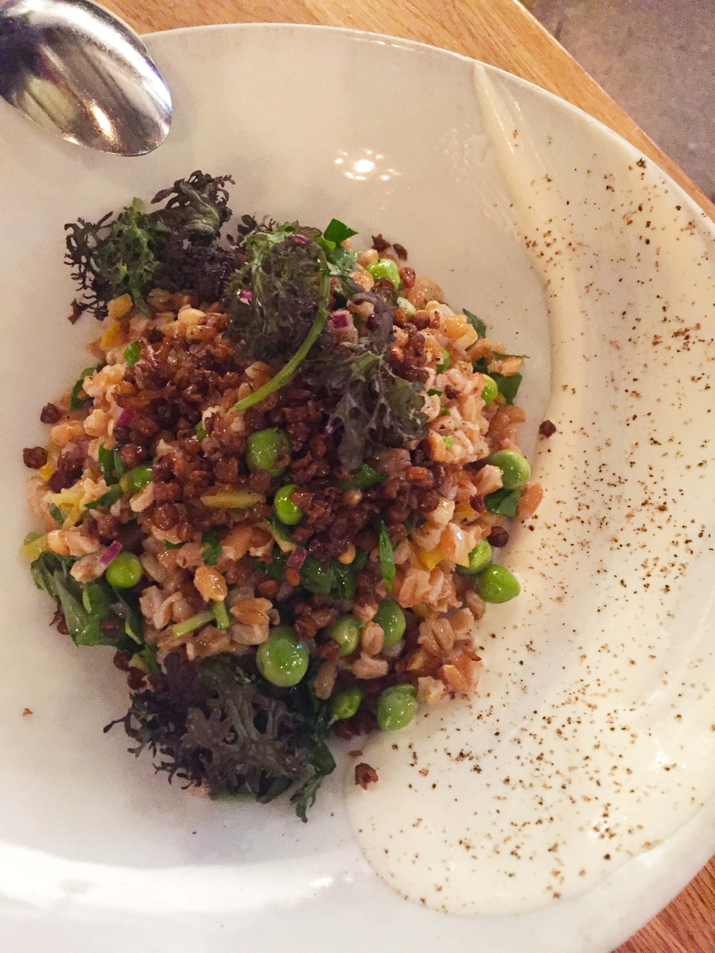 Farro Salad with crème fraîche,English peas,pine nuts,pickled sunchokes,fried lentils, and herbs.