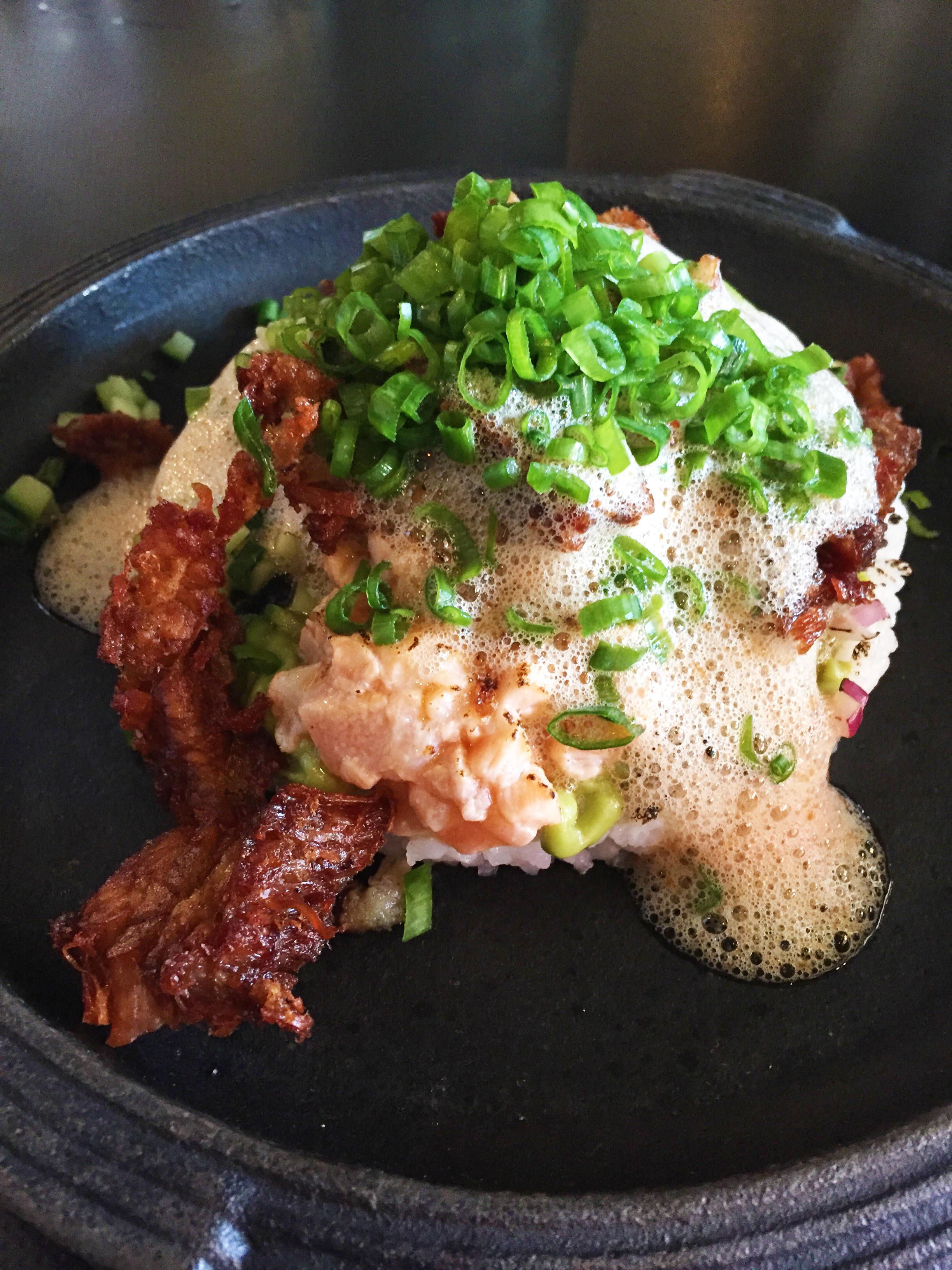 Dirty Rice with sushi rice, crispy pork belly, and salmon sashimi.