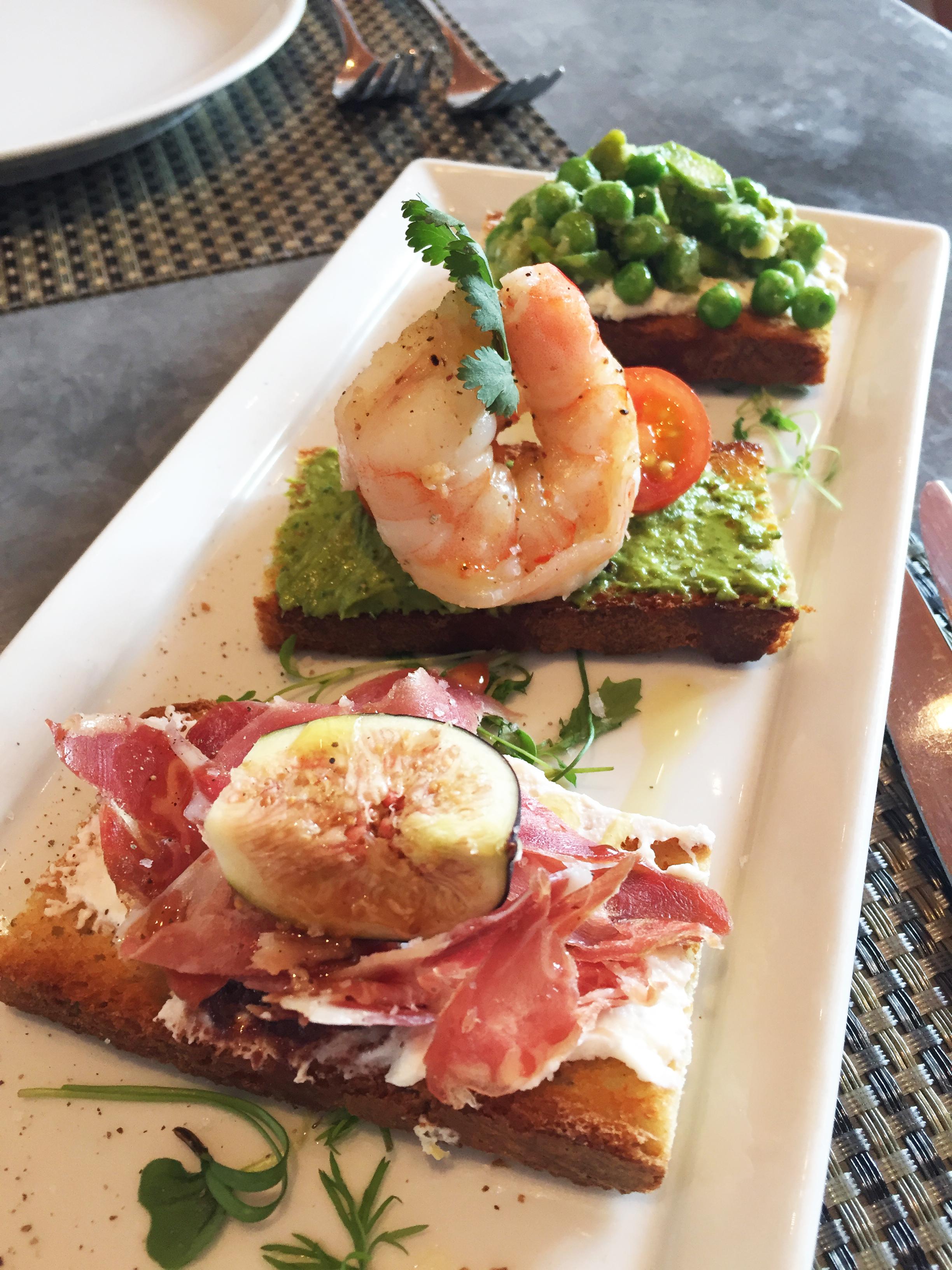 Crostini  (front to back) : Prosciutto | ricotta, fig, olive, walnut Shrimp | avocado, cilantro, tomato Pea | asparagus, ricotta lemon thyme